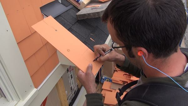 Pollard darkens his scribed line so as to be able to see clearly as he cuts the line with a jigsaw.