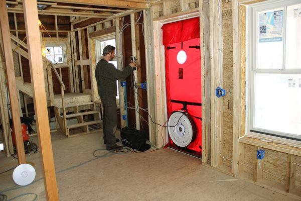 Harvey Johnson fires up the blower door and starts the test.