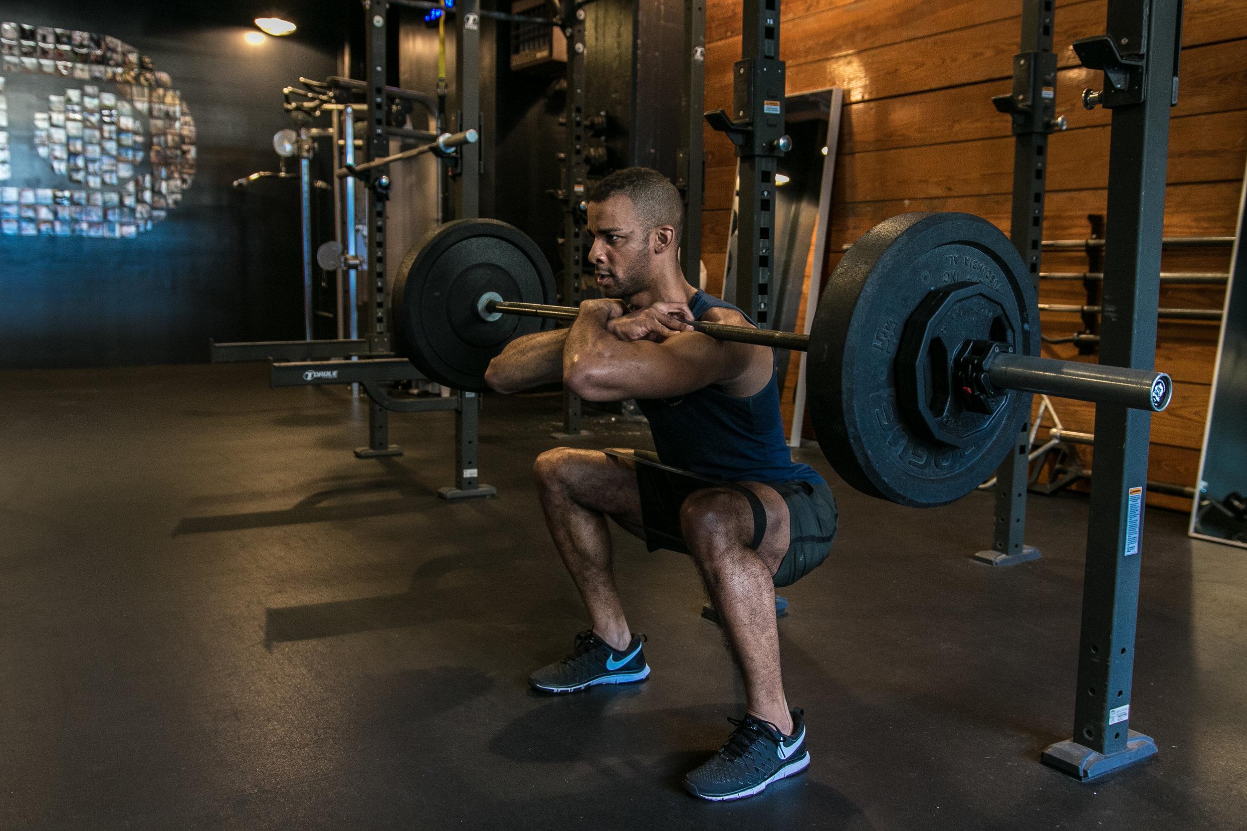 DIAKADI Trainer Joe Andrews front squat.jpg