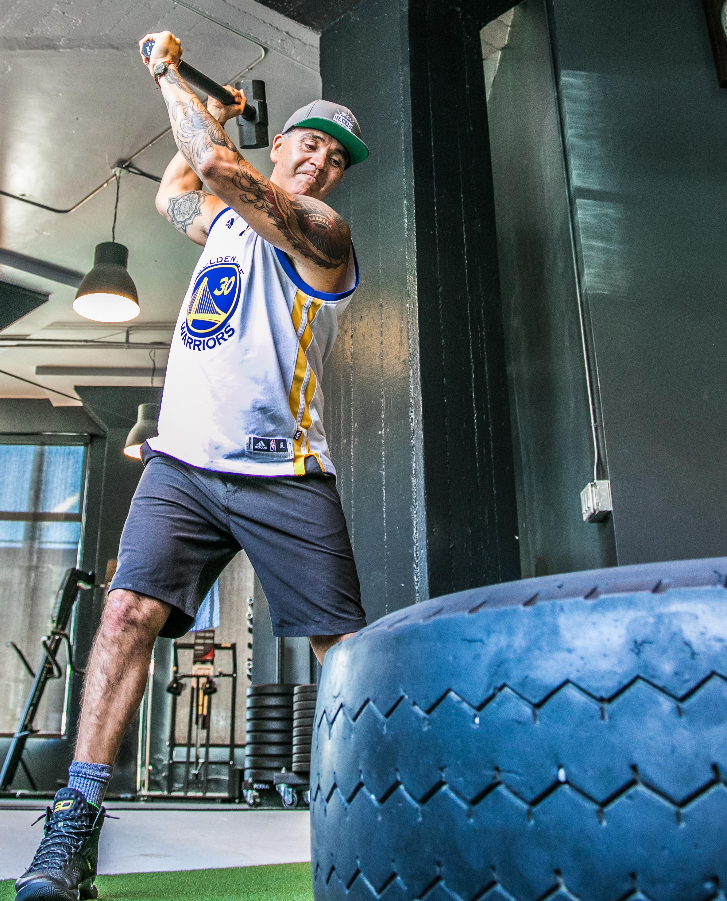DIAKADI Trainer Tommy Armenta tire swings.jpg