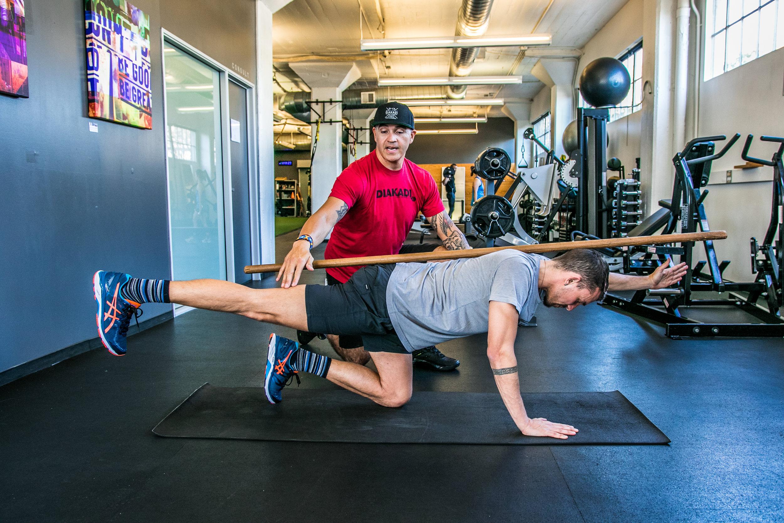 DIAKADI Trainer Tommy Armenta bird-dog posture improvement.jpg