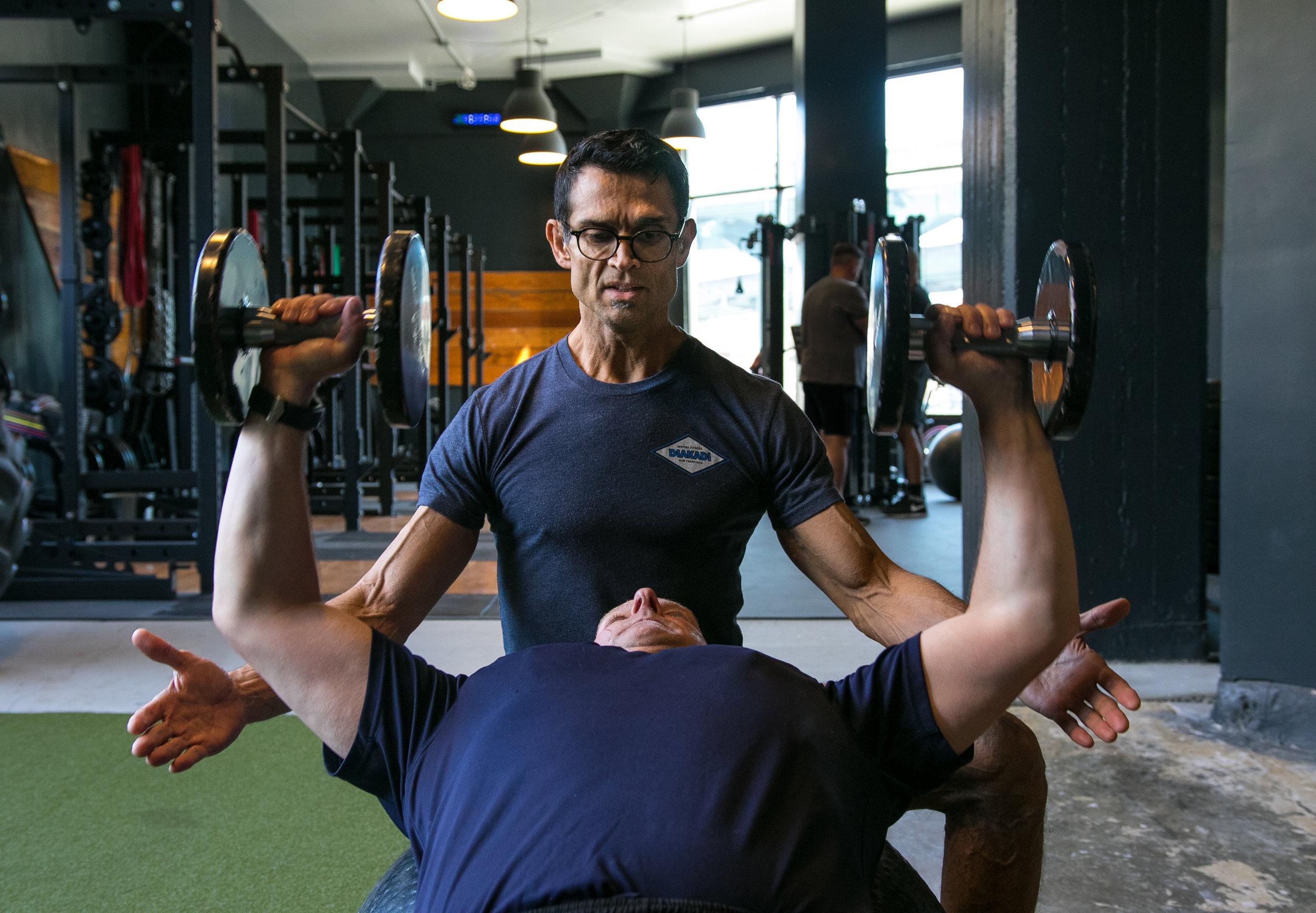 DIAKADI Trainer Jesse Garcia swissball dumbell bench press.jpg