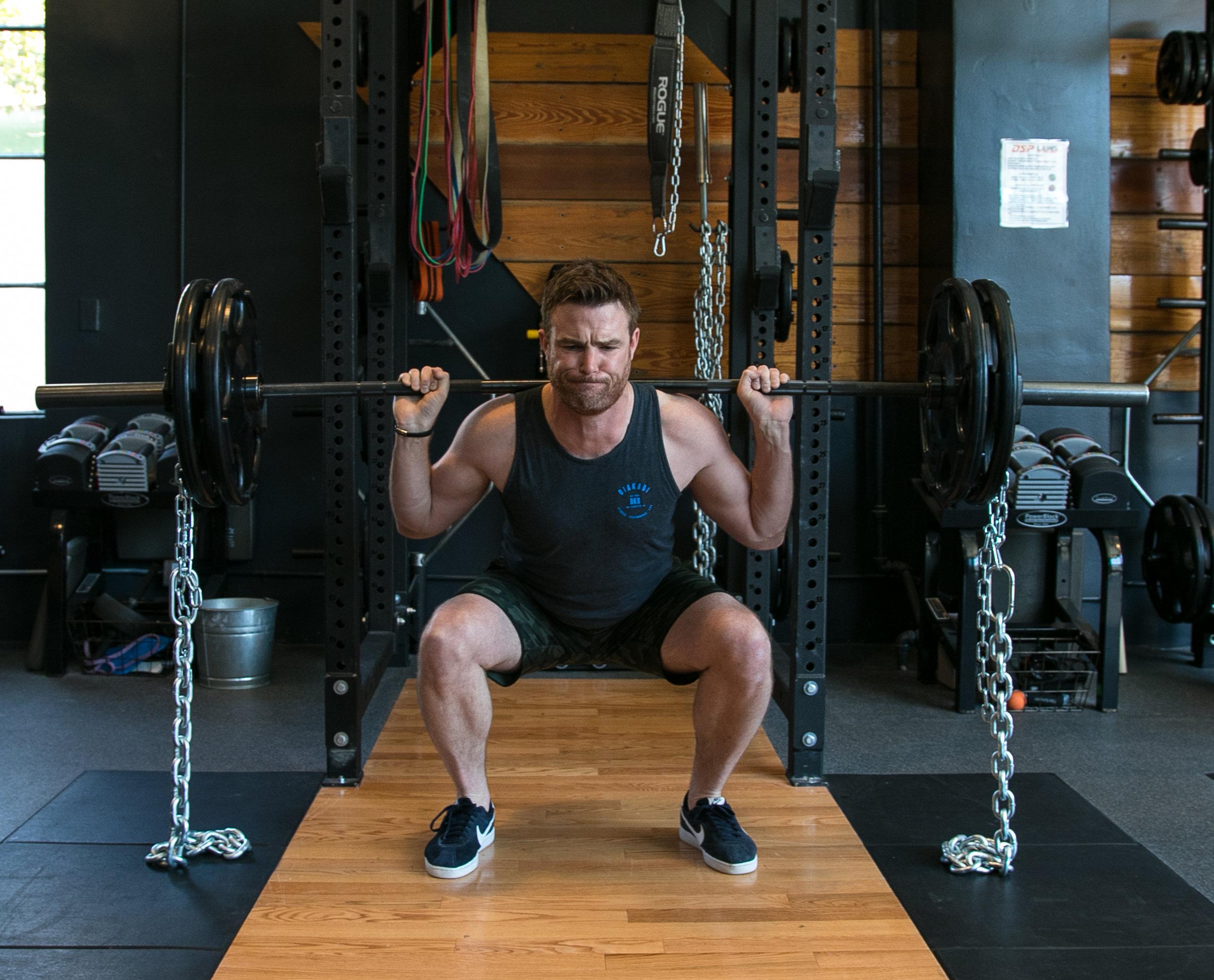 Gavin Birmingham barbell squat chains stability strength balance.jpg