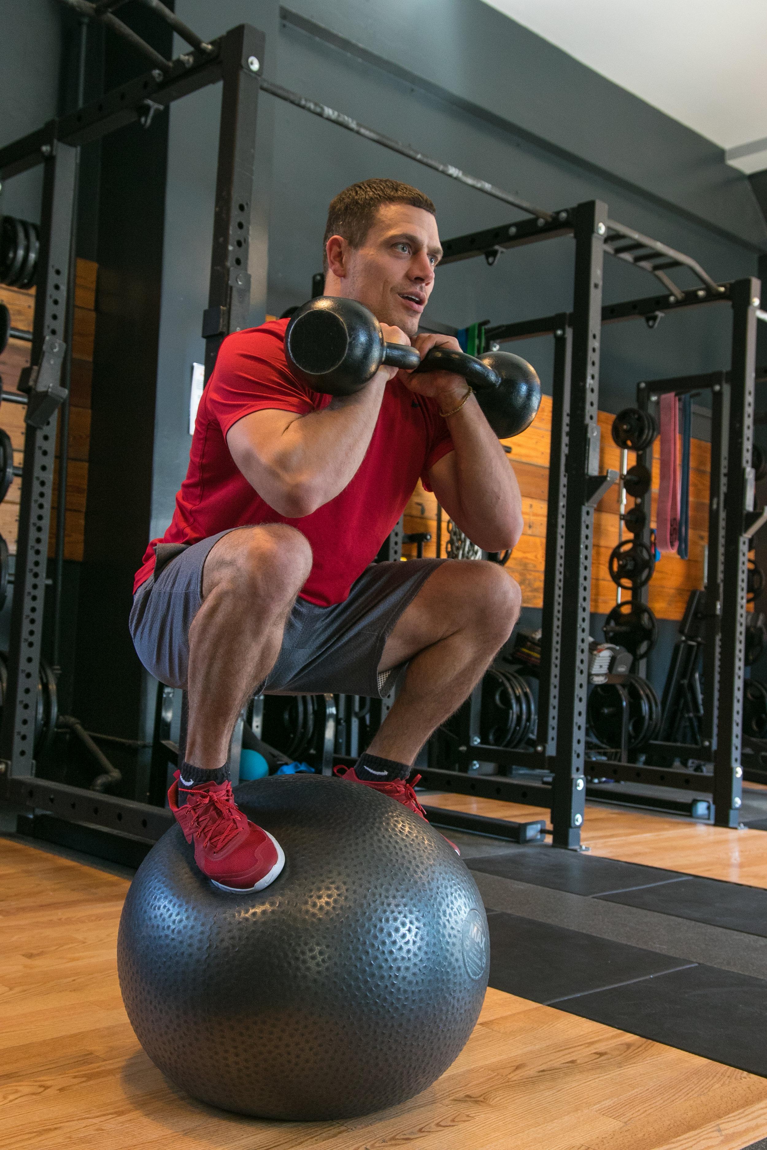 Tycho Bergquist stability ball kettle bell squat NASM ACSM.jpg