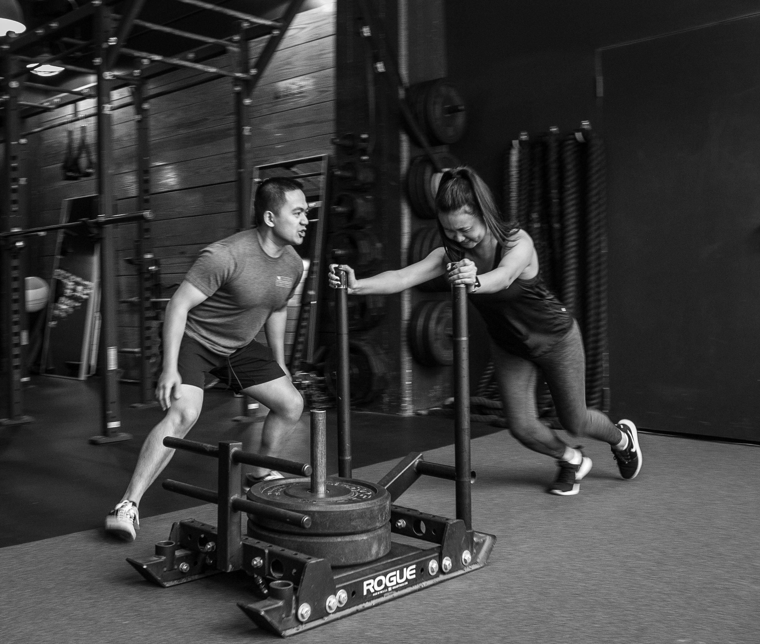 DIAKADI sled push Austin Villamil strength training.jpg