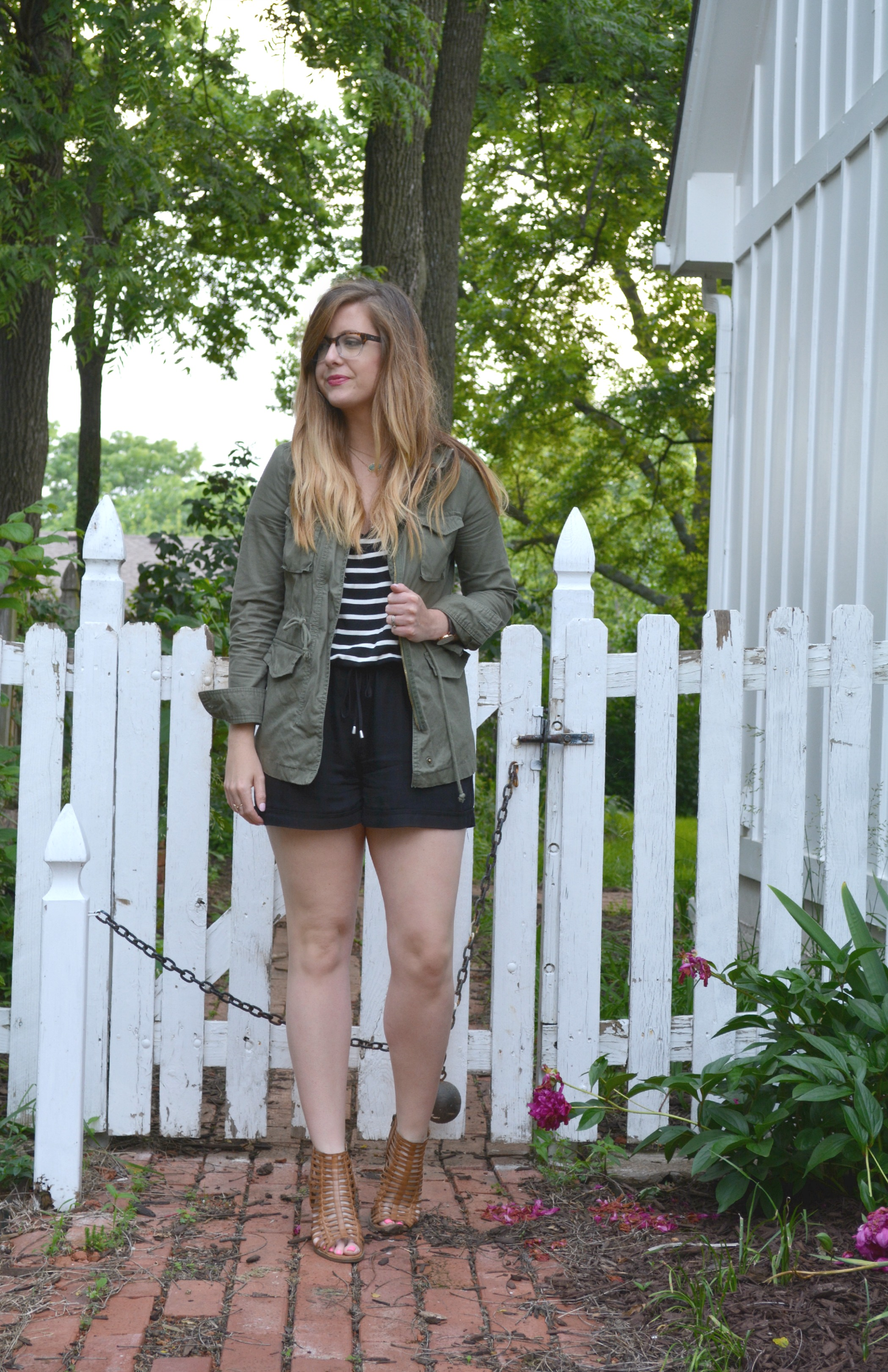 Polette eyewear, green cargo jacket, and stripe Anthropologie romper on Sophisticaited.com