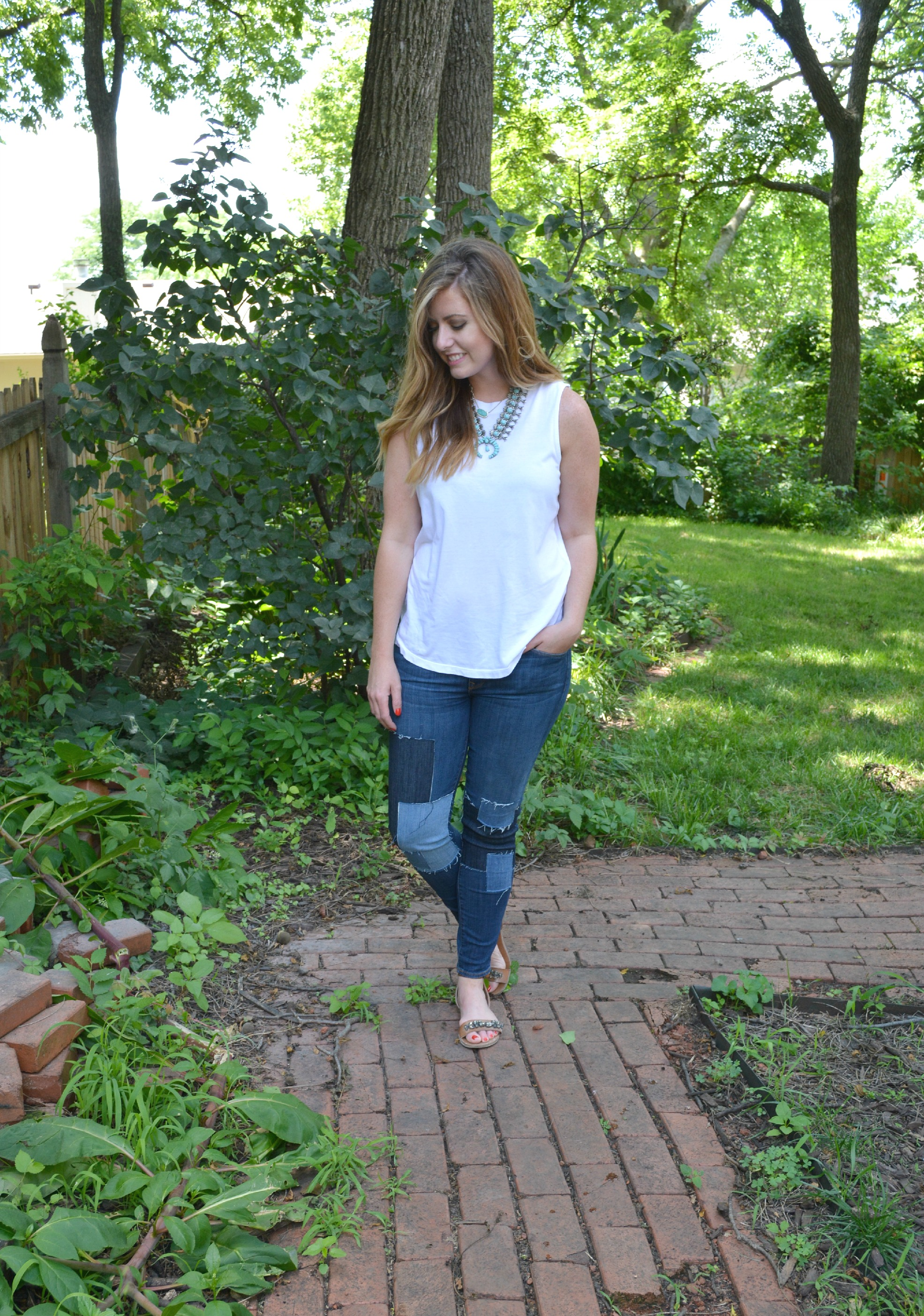 Muscle tank and Baldwin jeans and Capri Amulet necklace on Sophisticaited