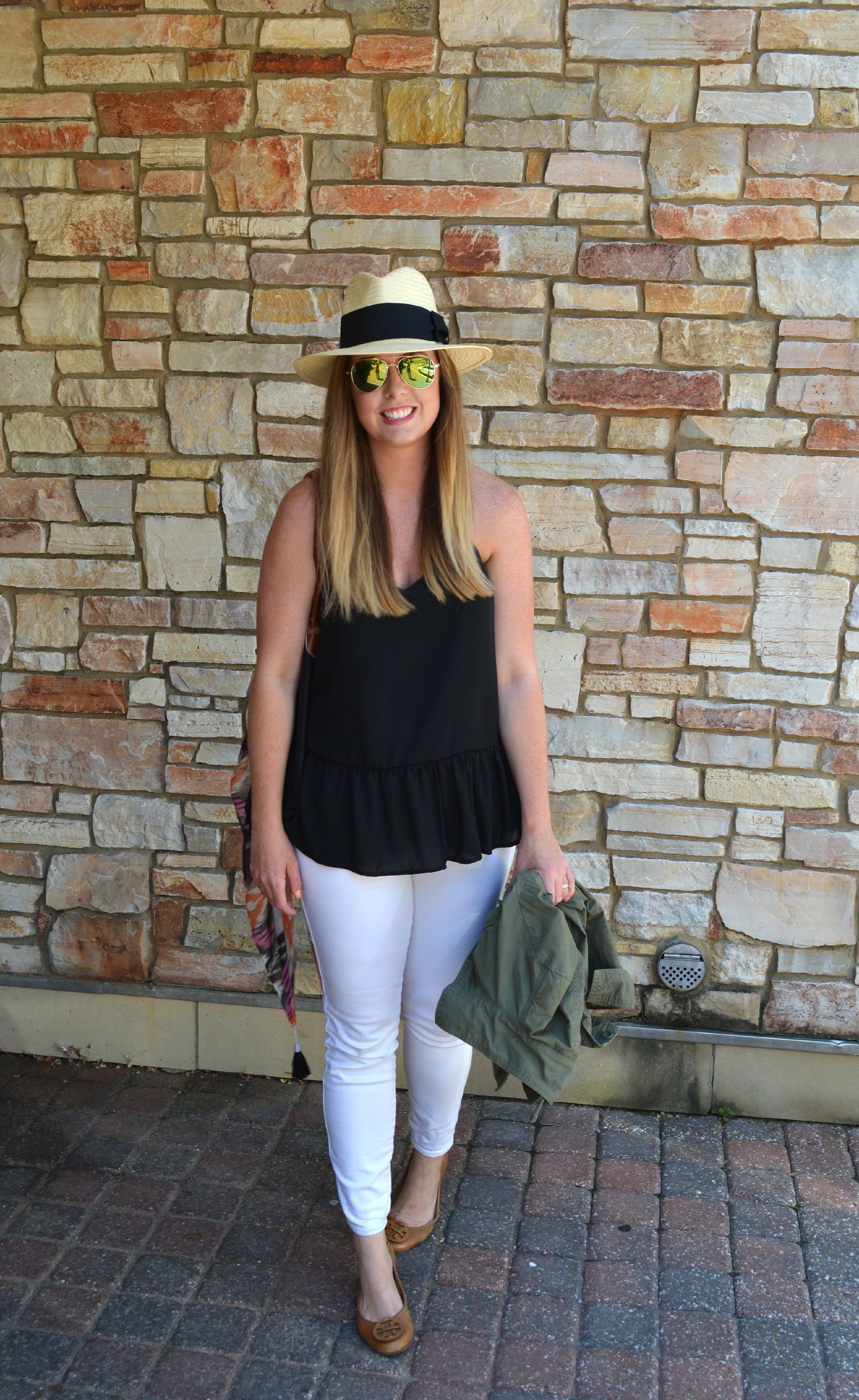 Straw fedora black tank and white jeans on Sophisticaited