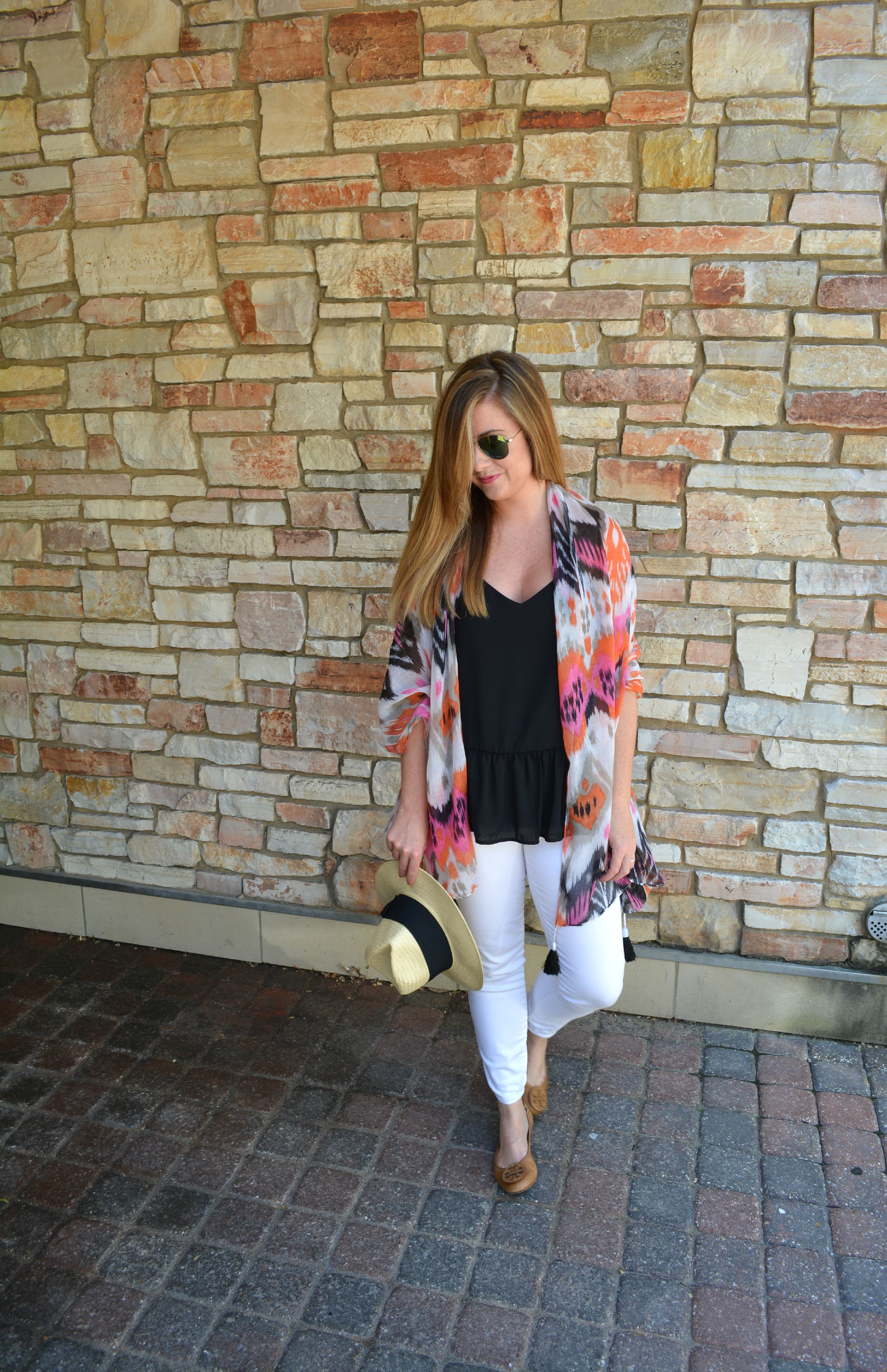Summer travel outfit on Sophisticaited