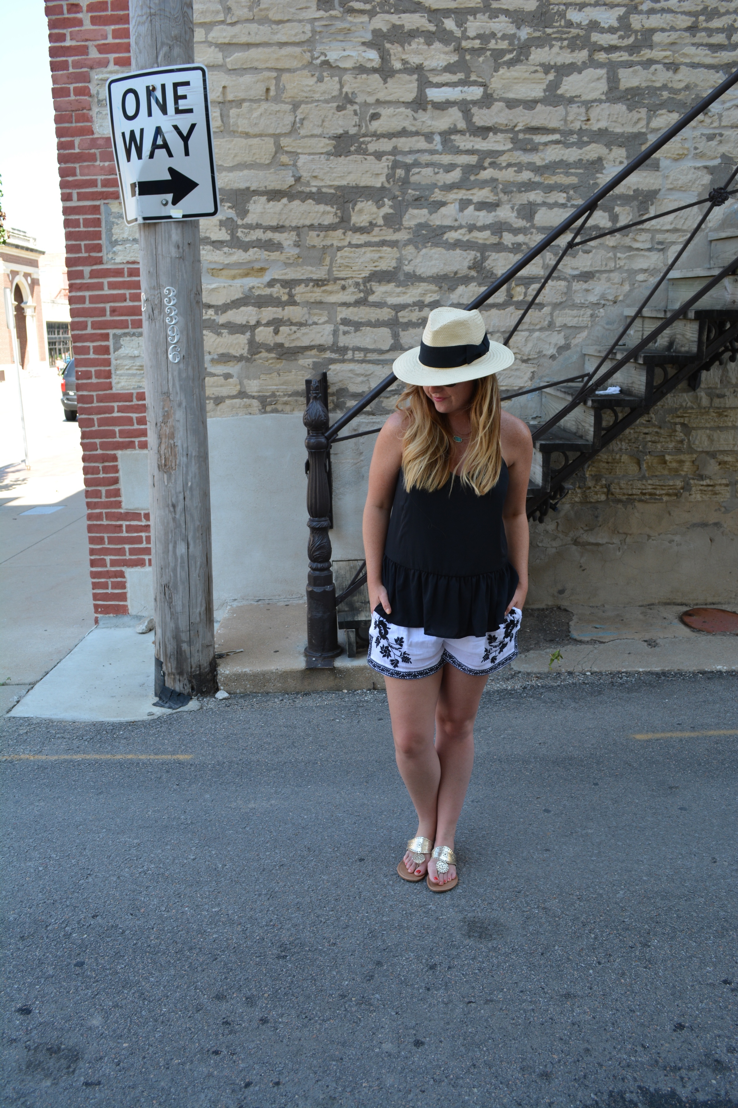Panama hat, black tank with embroidered shorts on Sophisticaited.com