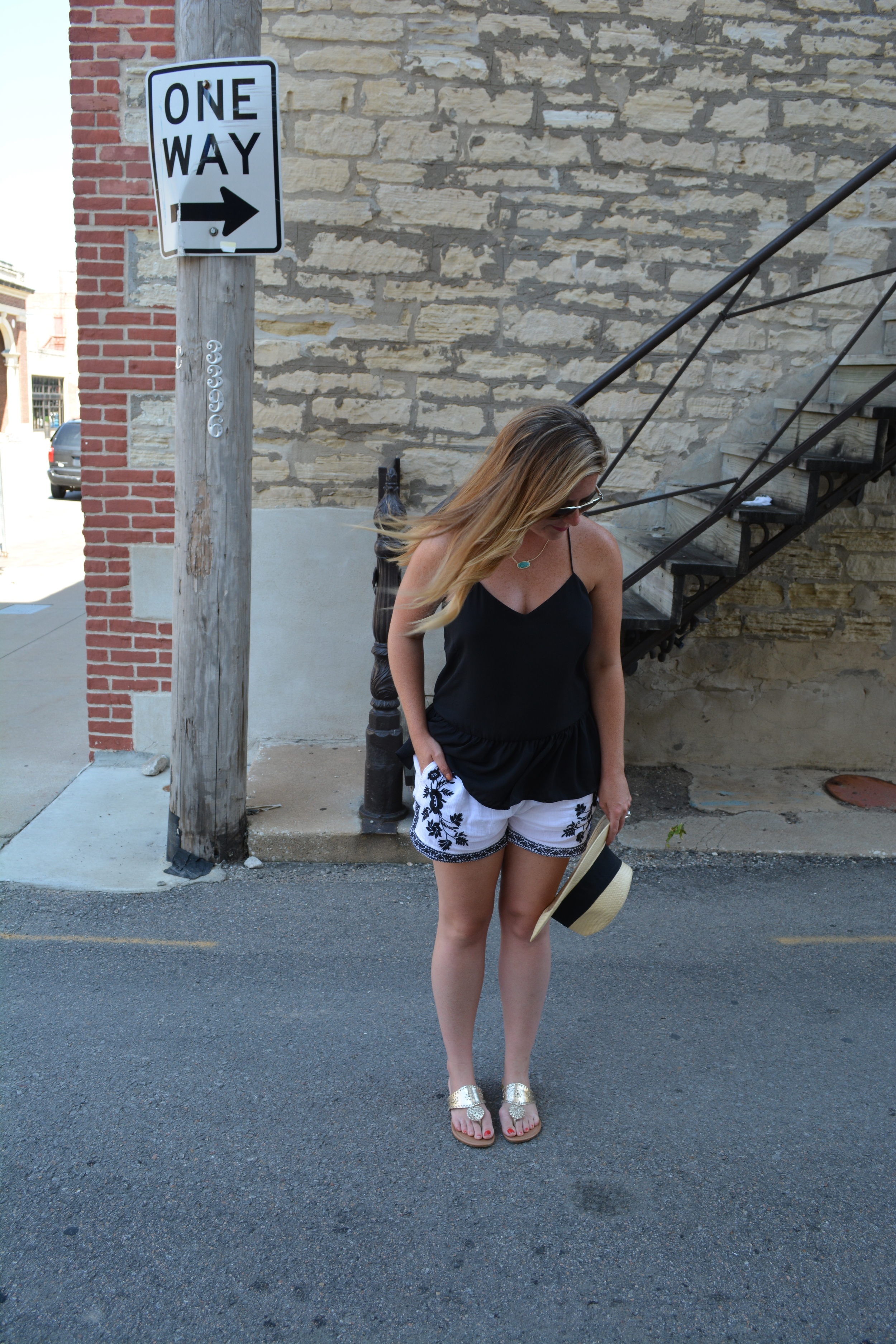 Black tank with white and black embroidered shorts on Sophisticaited.com