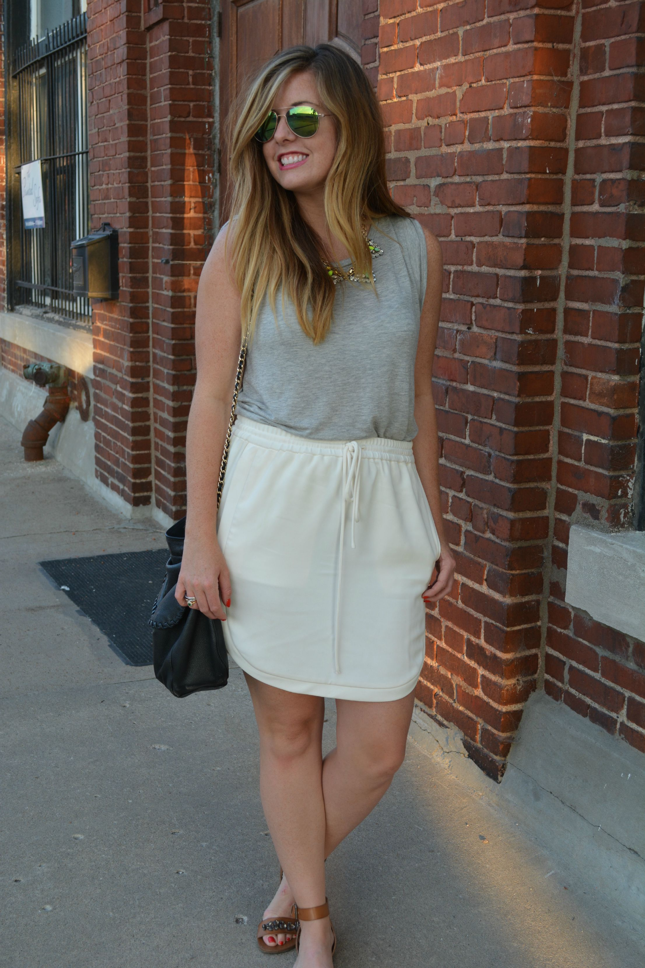 Gray tank with ivory skirt tank sandals on Sophisticaited.com