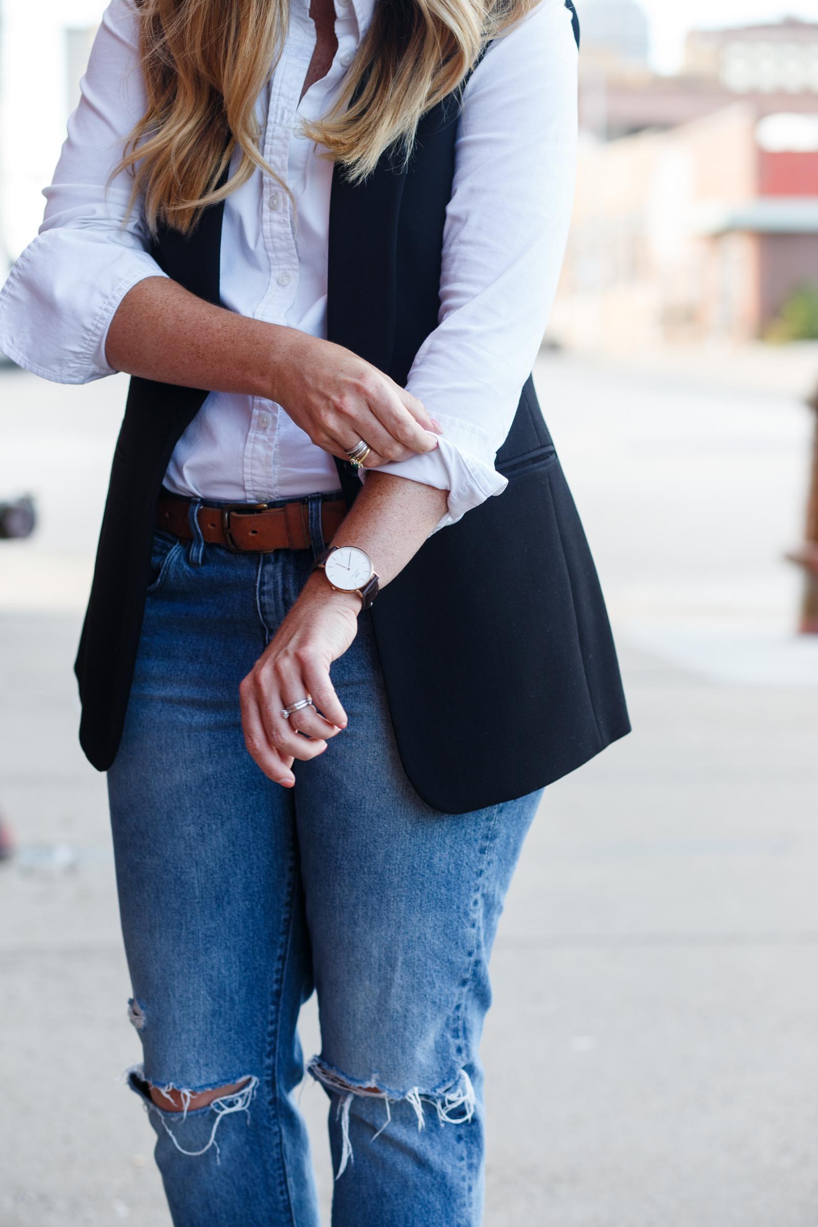 White button down black vest with boyfriend jeans on Sophisticaited.com