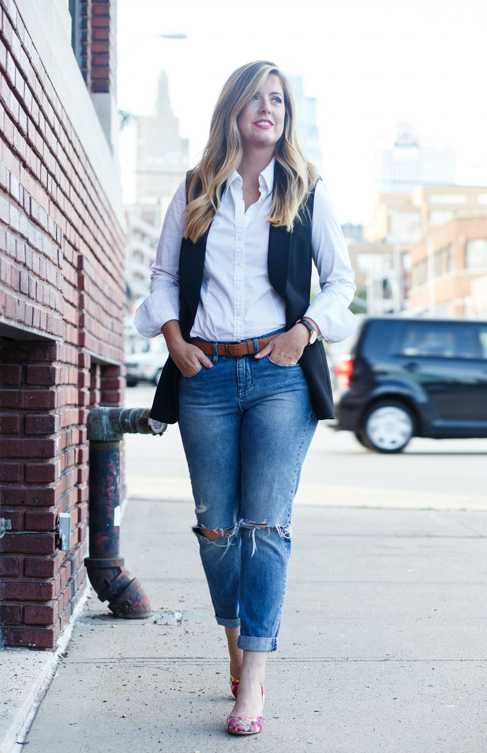 White button down shirt with black vest on Sophisticaited.com