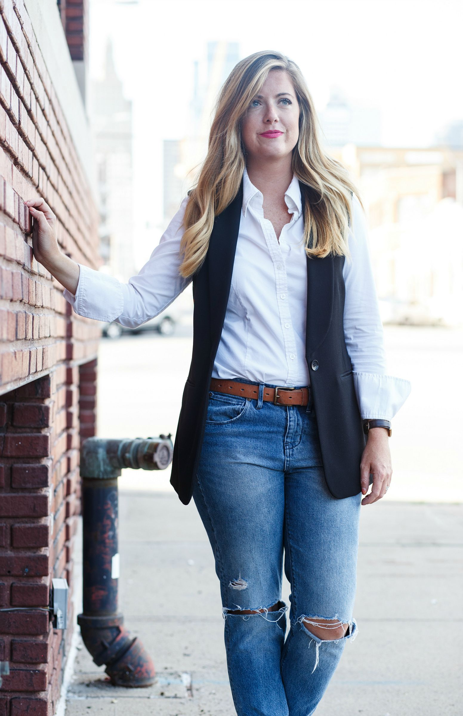 White button down with black vest and boyfriend jeans on Sophisticaited.com