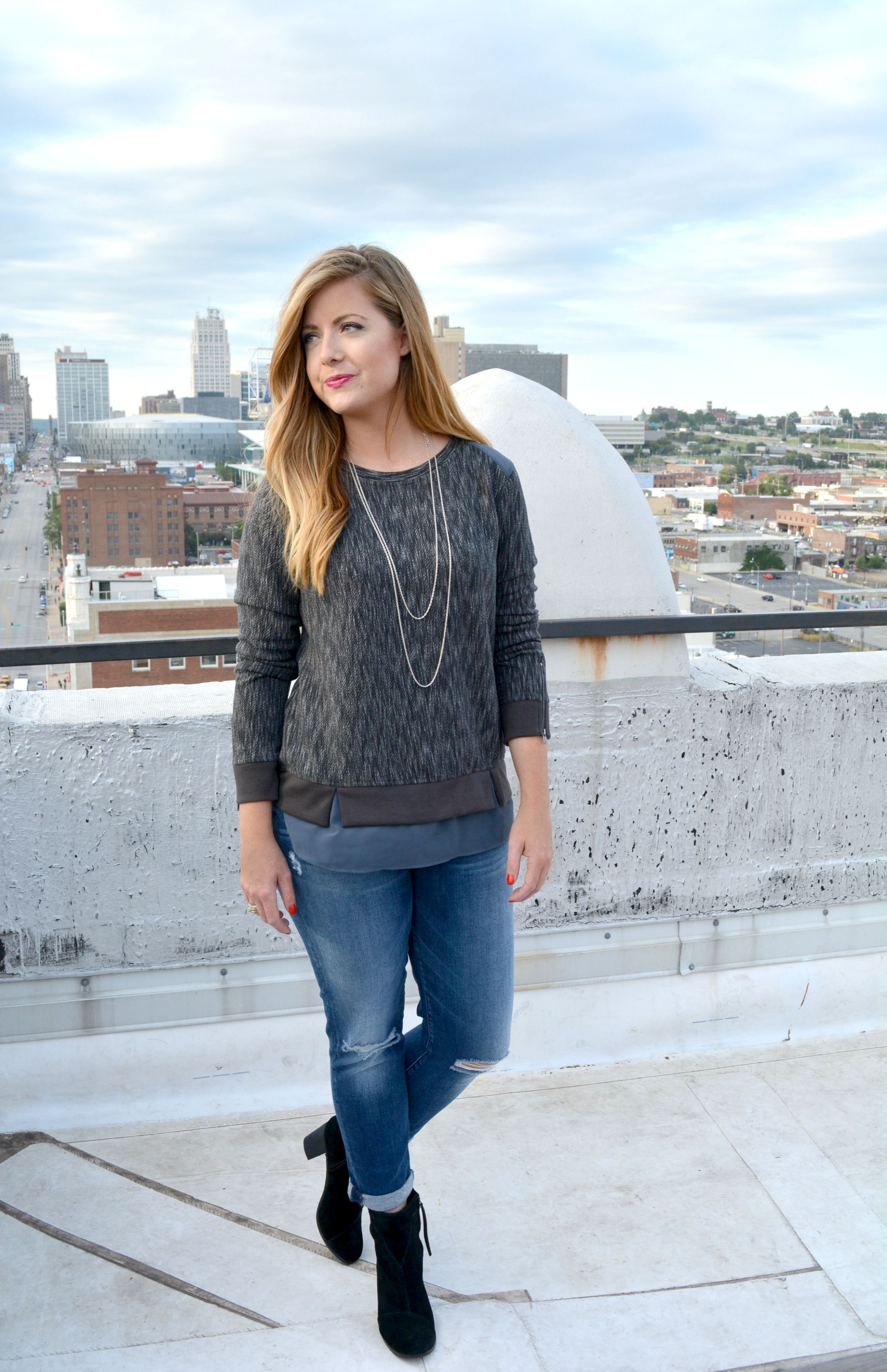 Fall sweatshirt with boyfriend jeans and black booties on Sophisticaited.com