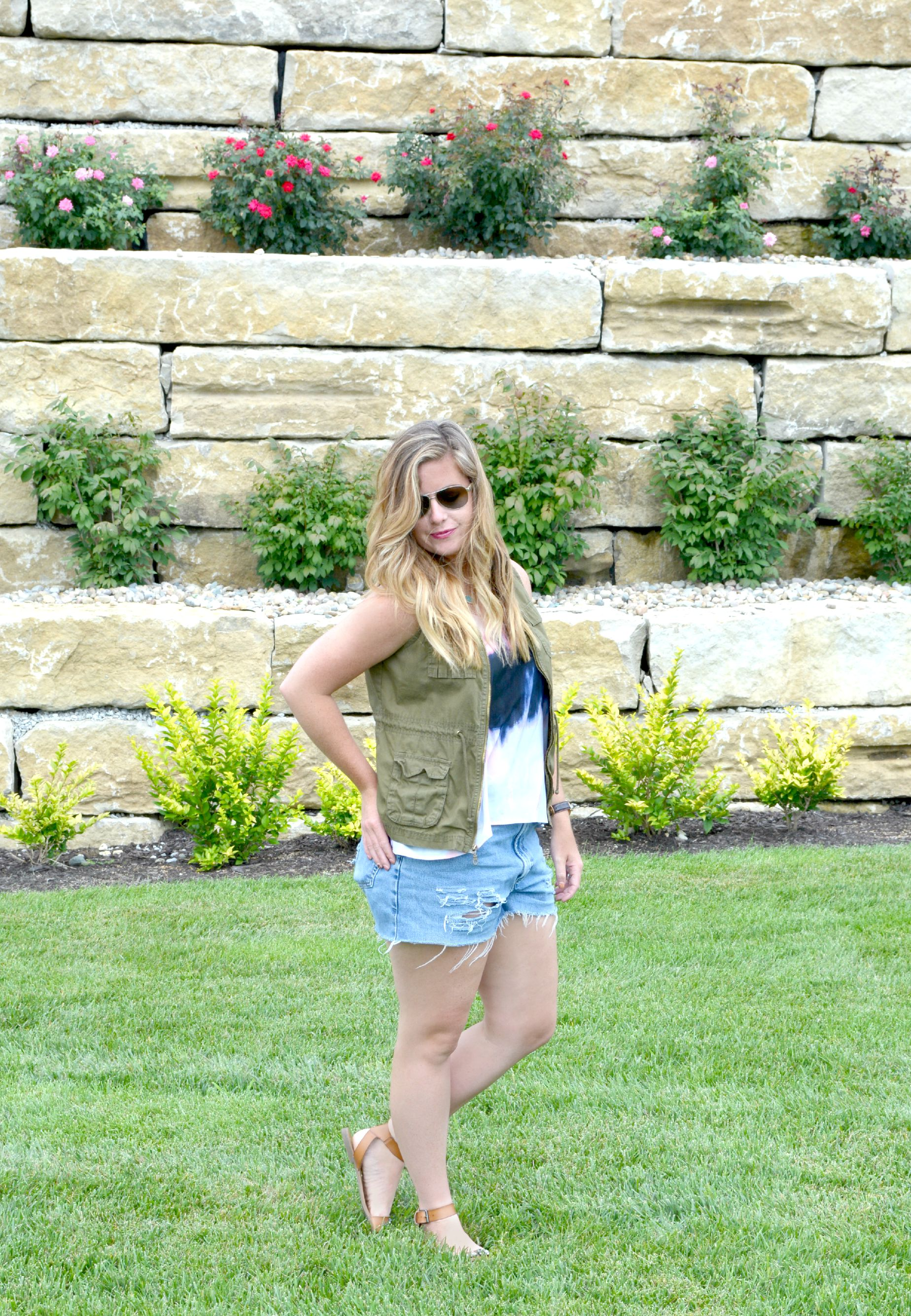 Summer Look: tie dye tank with cargo vest with vintage shorts on Sophisticaited.com