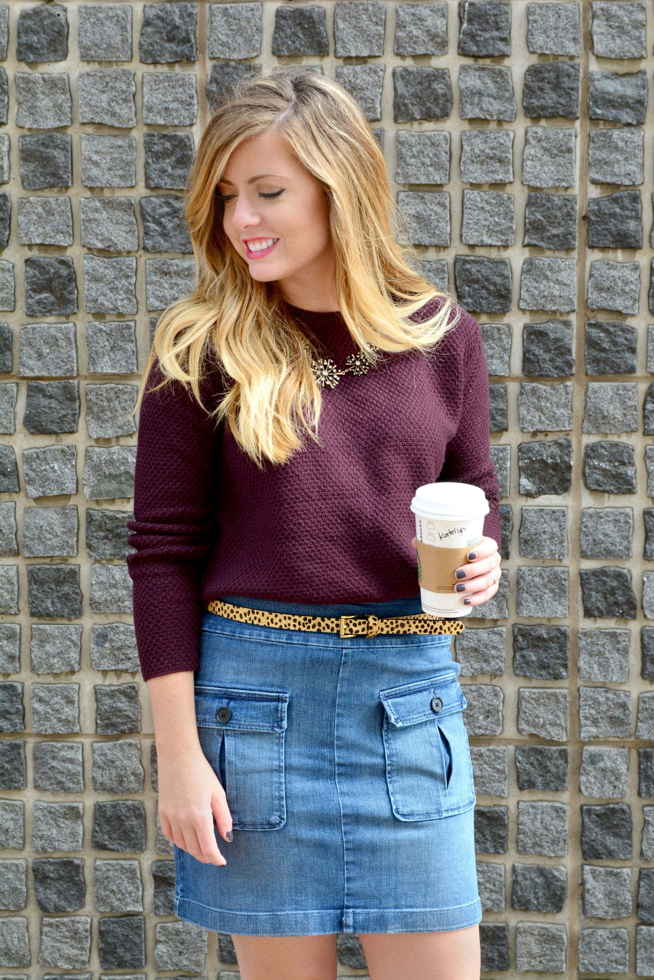 Maroon sweater with statement necklace leopard belt and denim skirt suede booties on Sophisticaited.com a fashion blog by stylist Cait Fore
