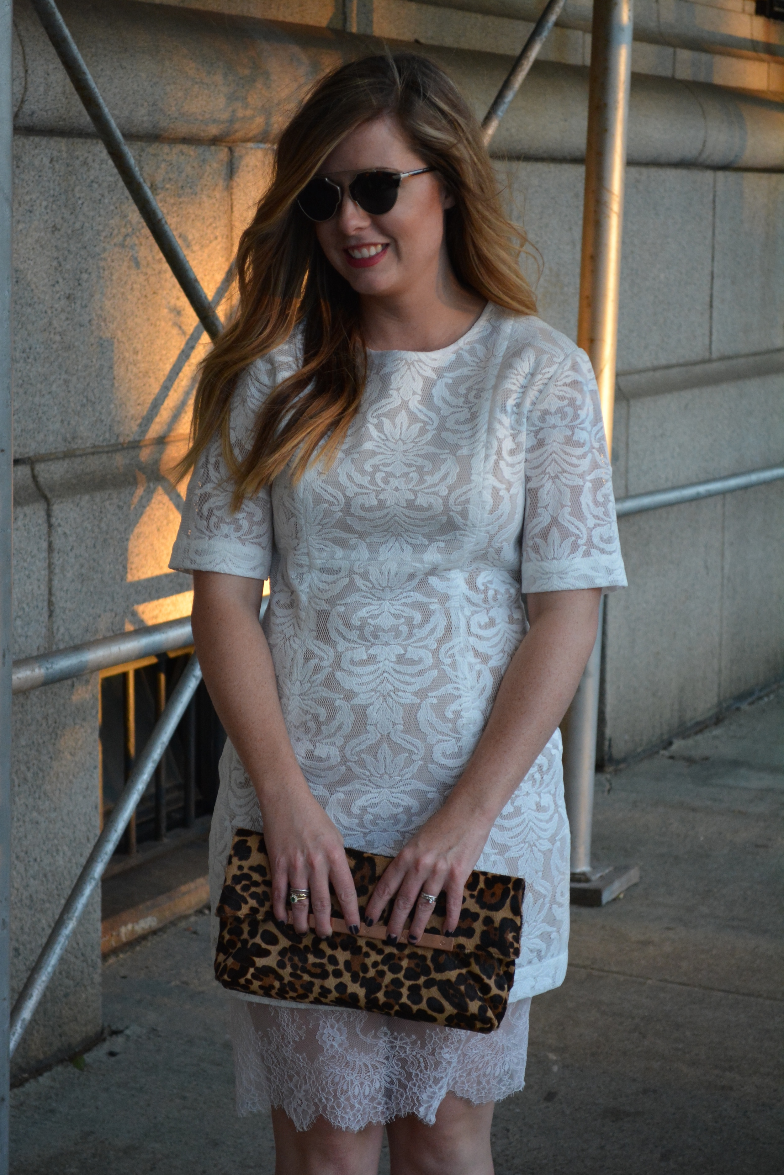 White lace dress with leopard clutch on Sophisticaited.com