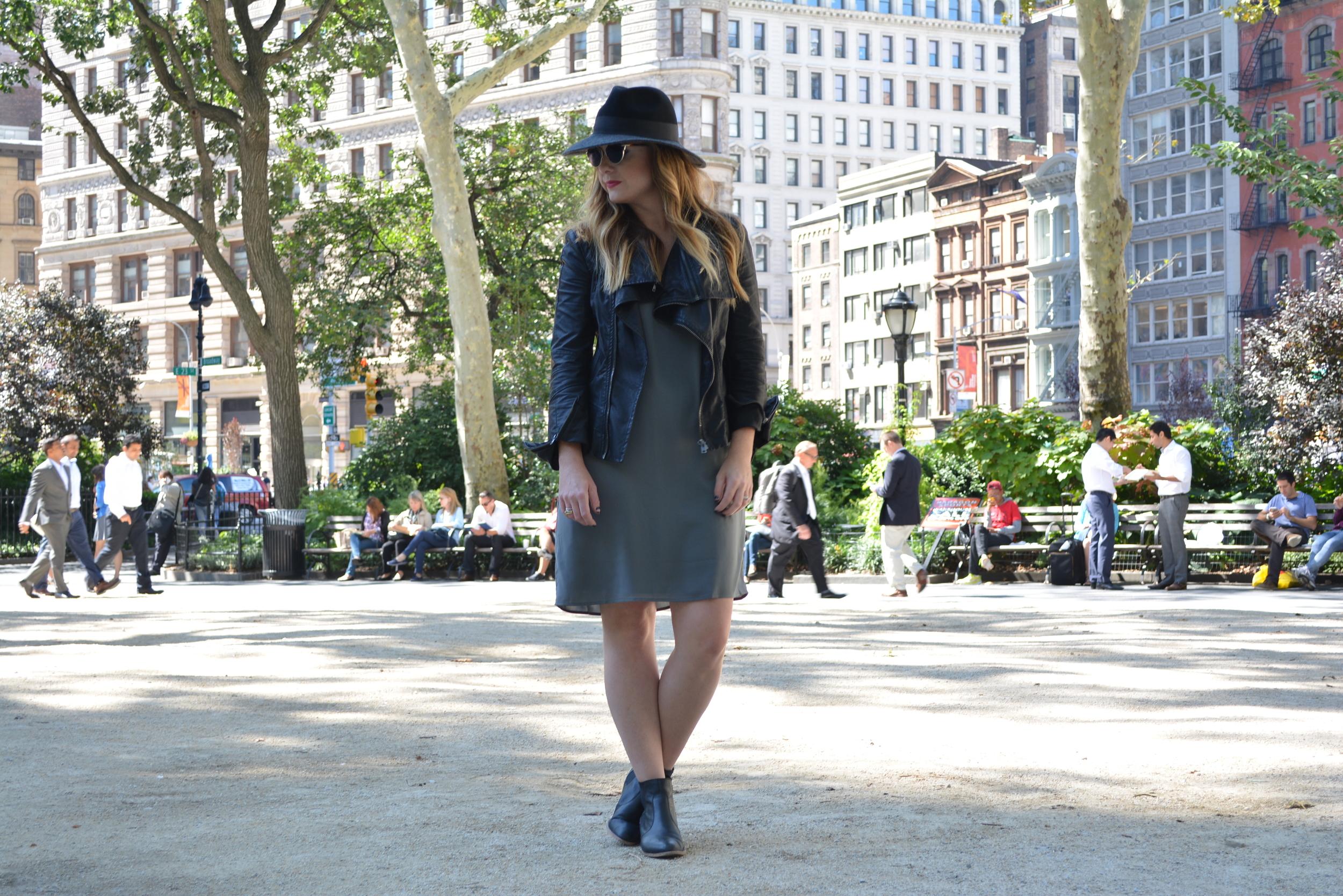 Wide brim hat, moto jacket, and shift dress