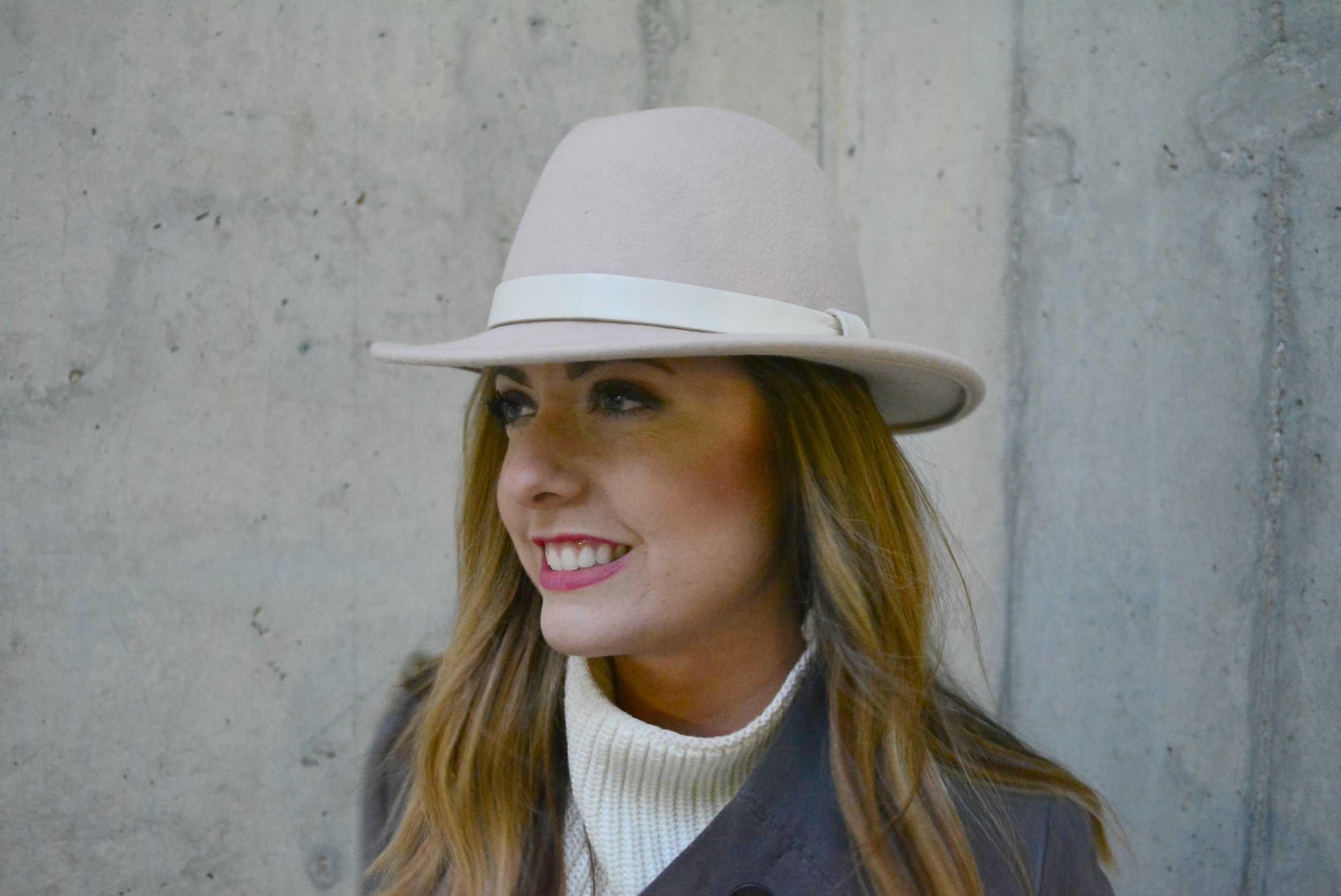 Pink J.Crew hat with soft colors for winter
