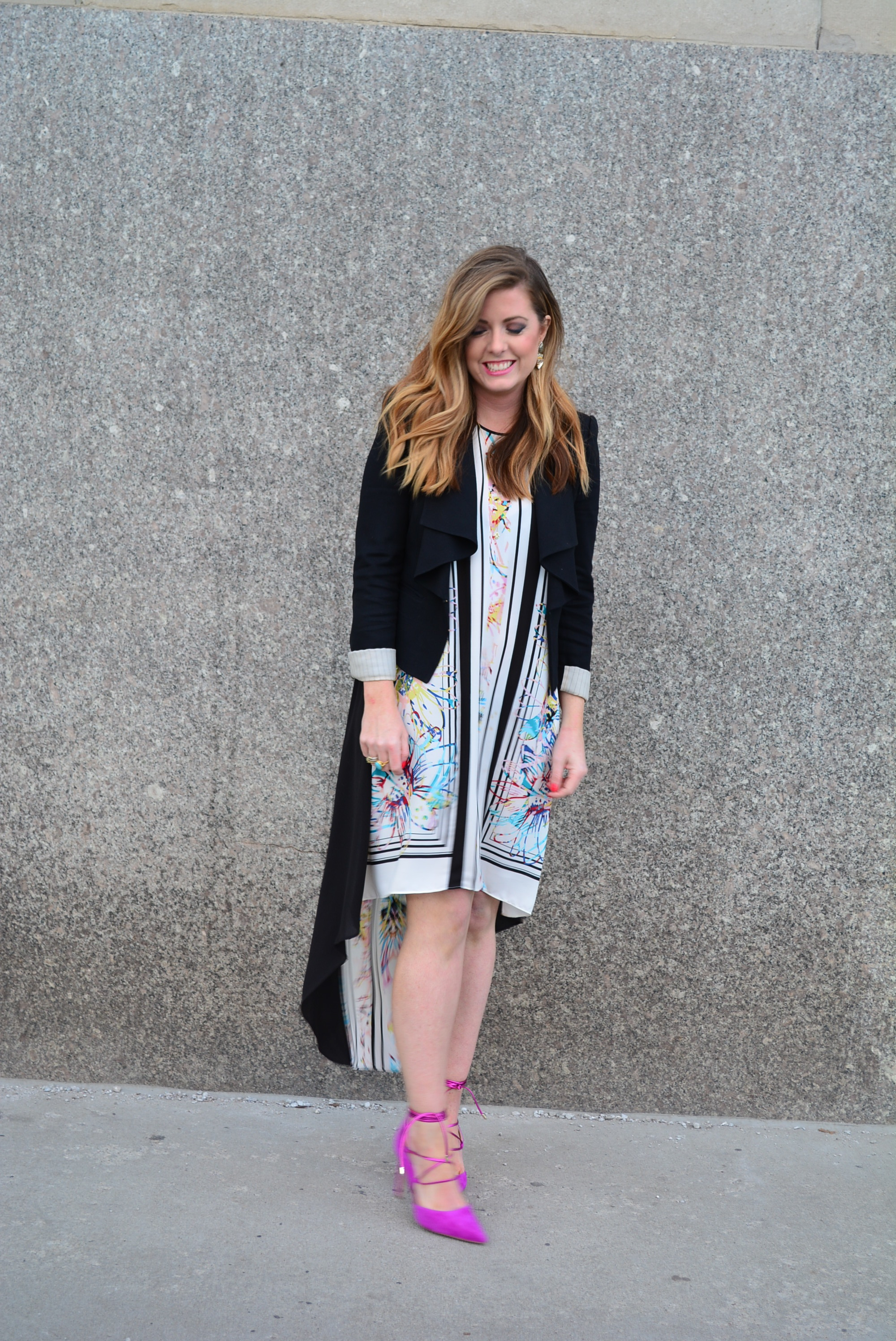 A structured black blazer paired with a high low maxi dress for Kansas City Fashion Week shows
