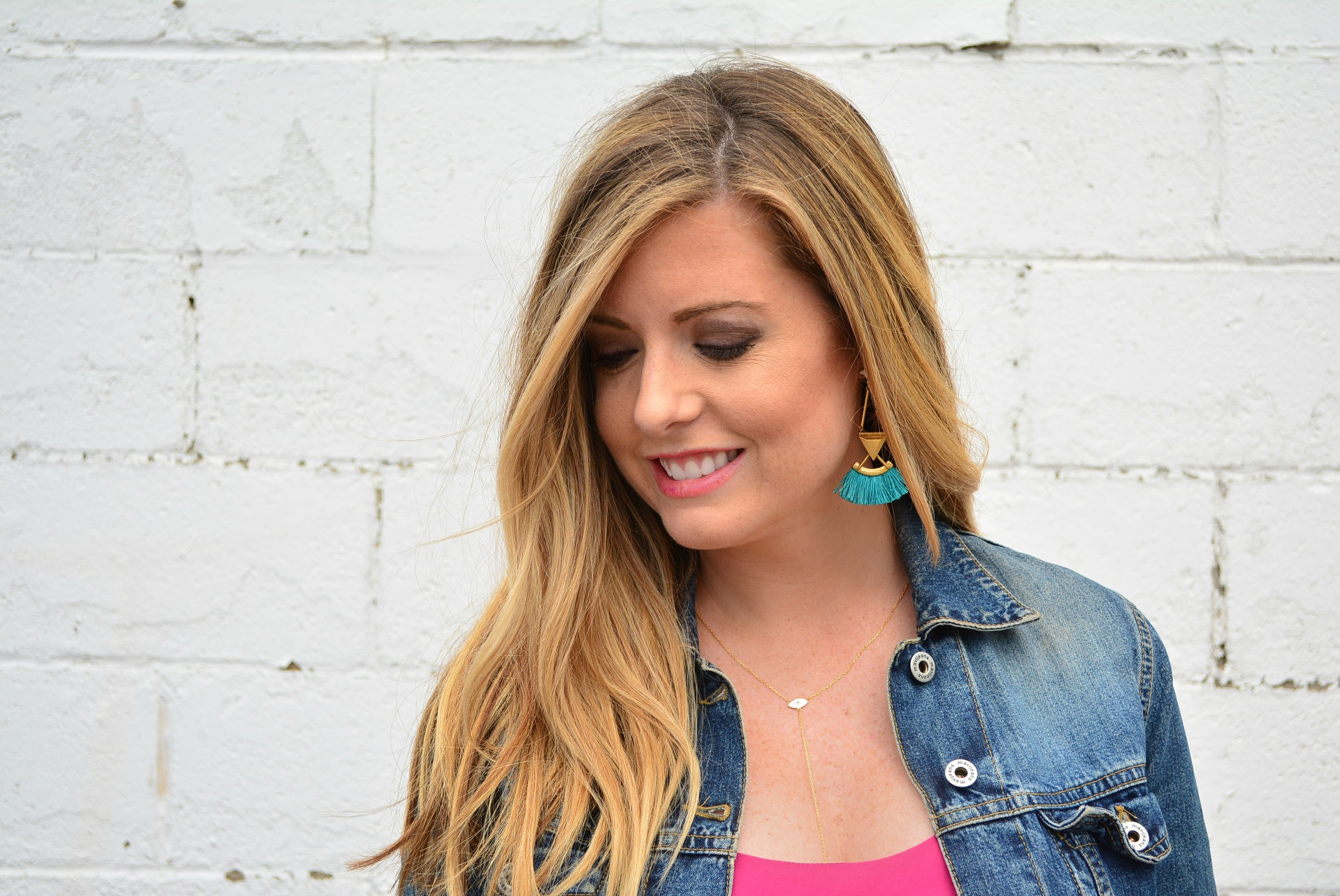 Maternity outfit of fuchsia maxi dress with denim jacket and turquoise tassel earrings