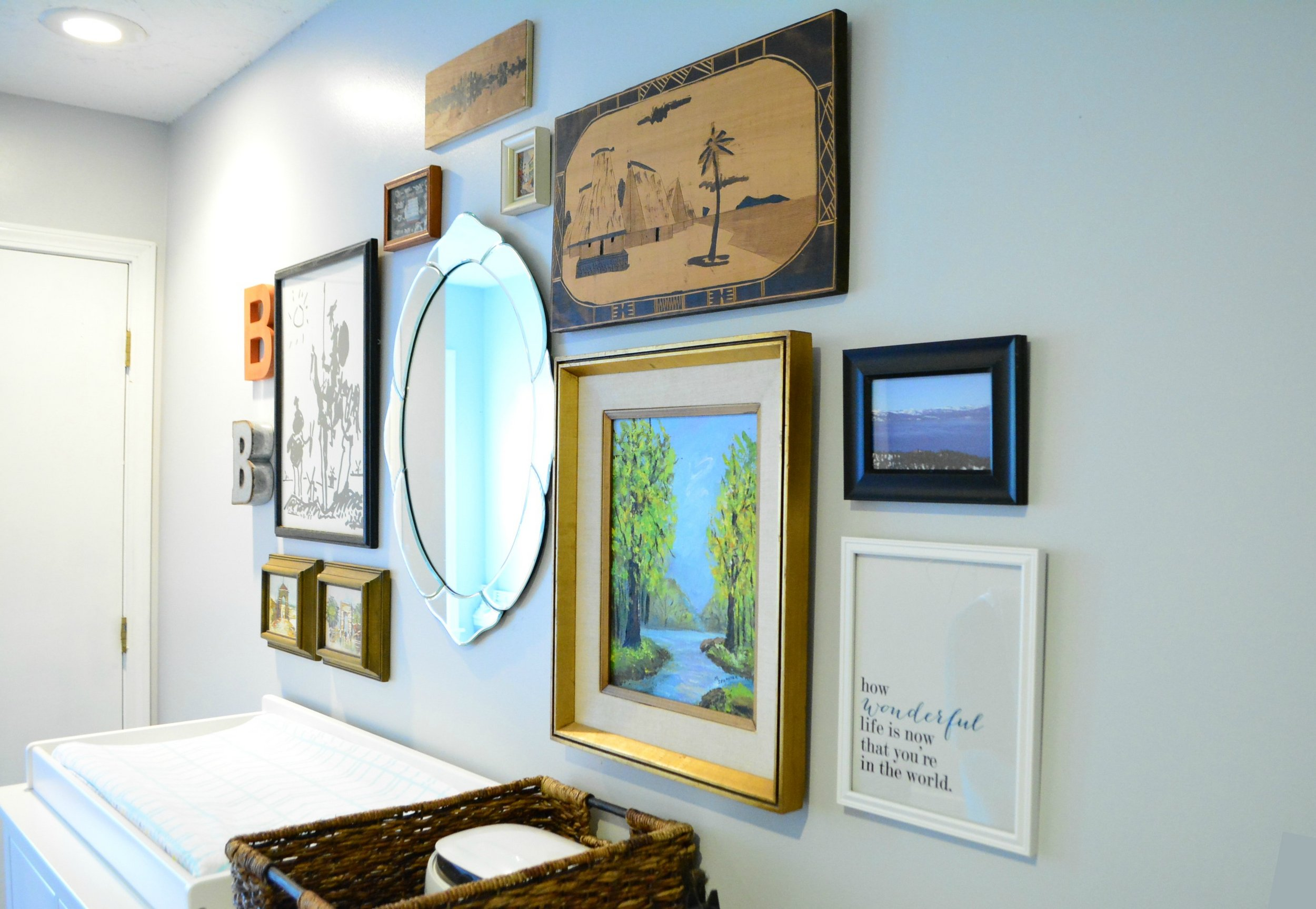 Baby boy nursery with a styled gallery wall