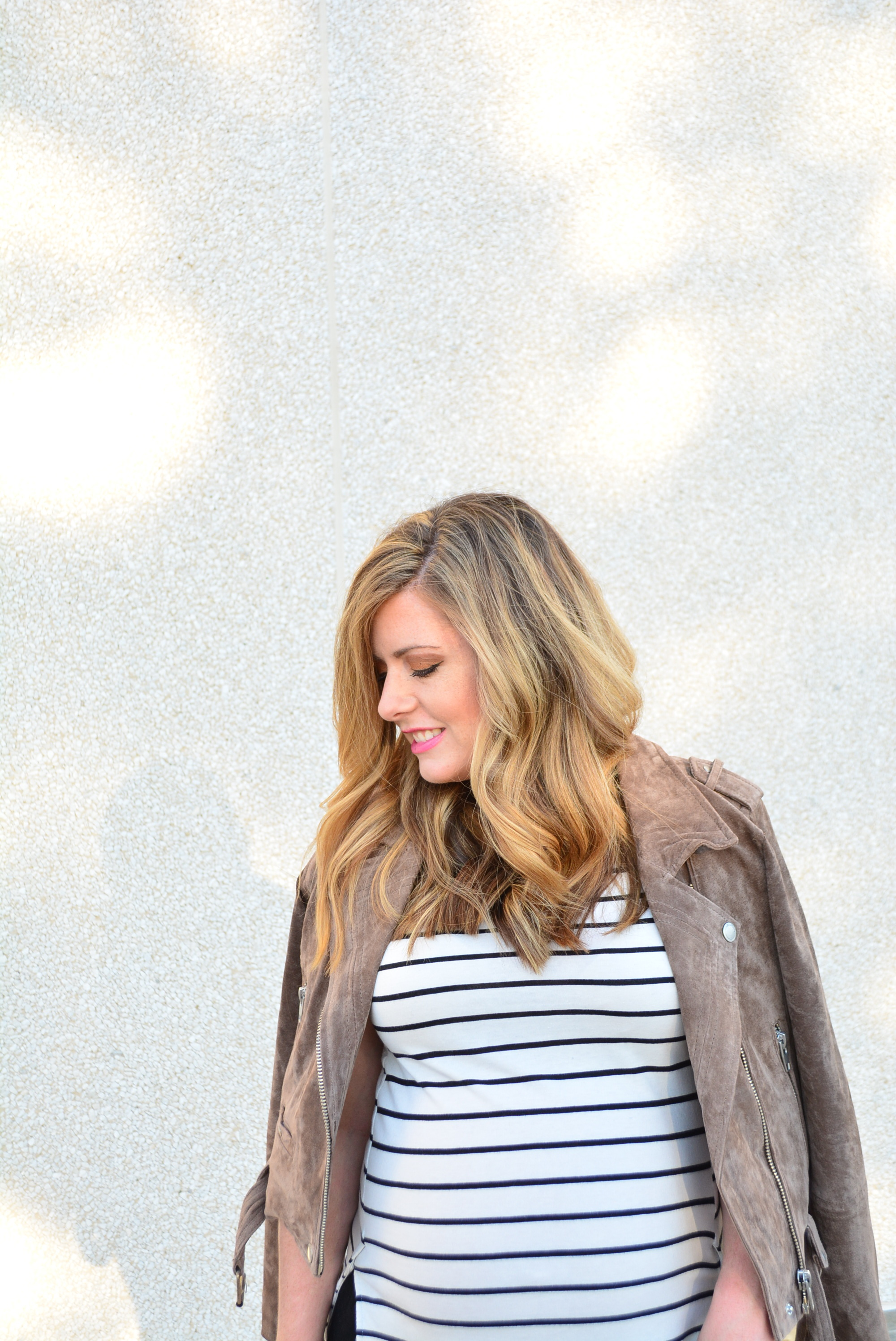 Moto jacket with stripe tee and joggers for a cute maternity look