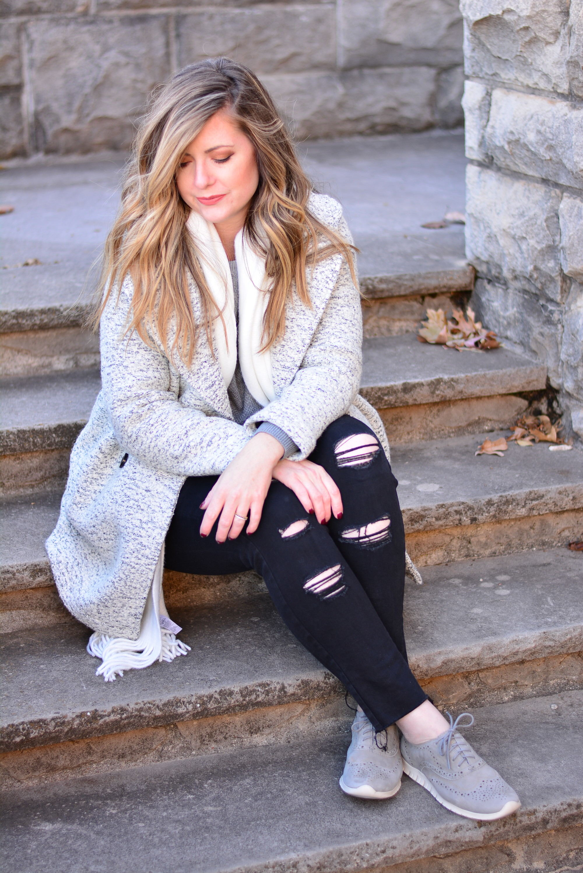 Gray sweater and black jeans winter coat