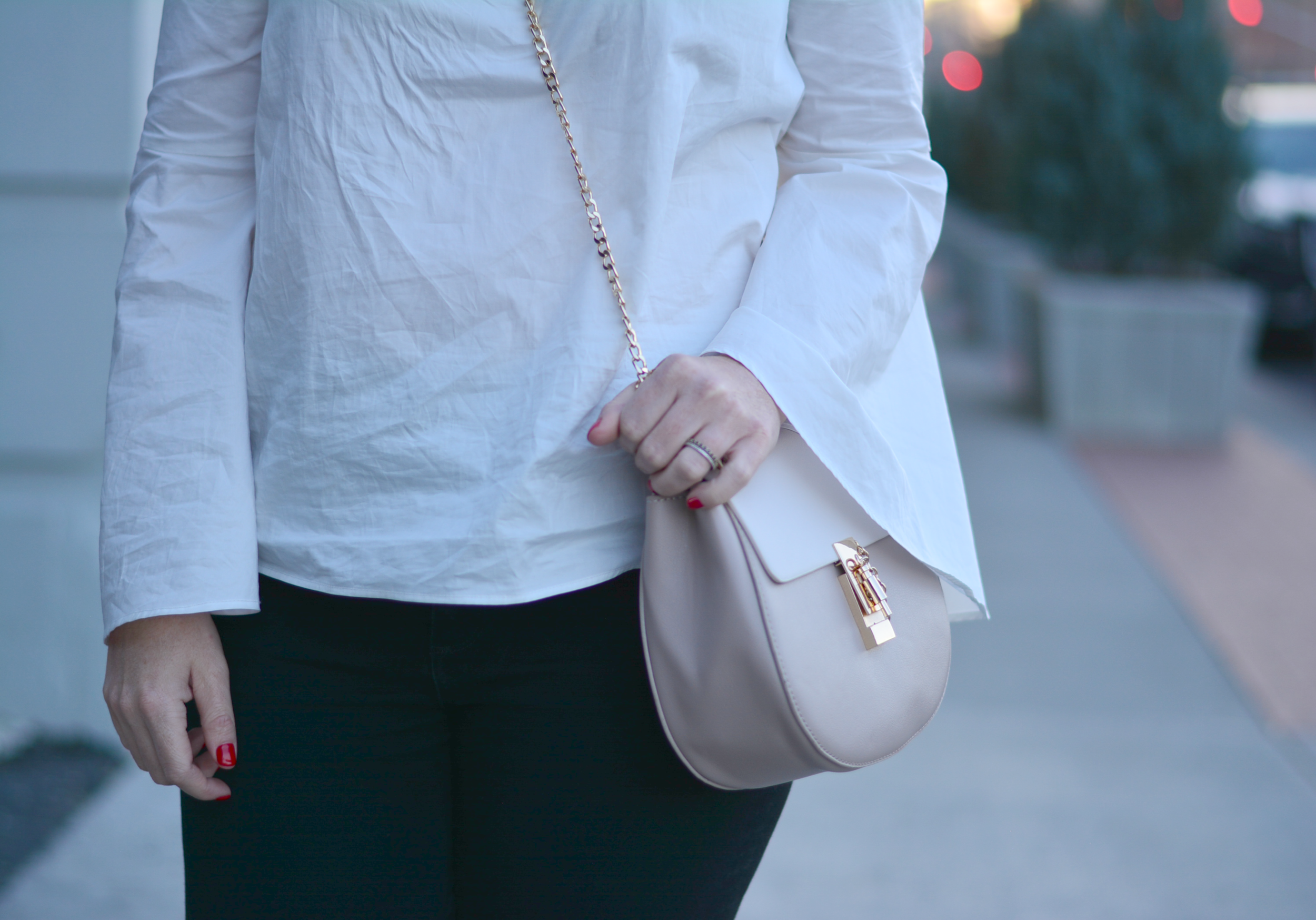 White bell sleeve top with black jeans
