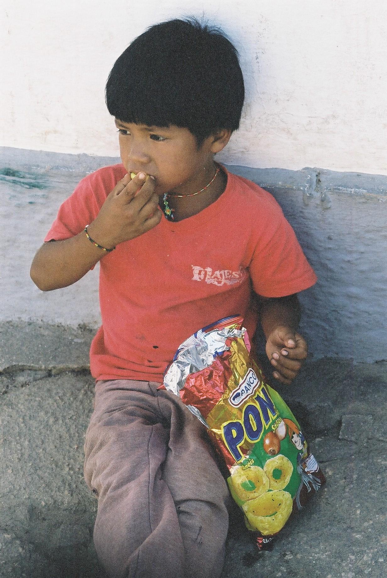 Boy Eating Chips, Parati.JPG