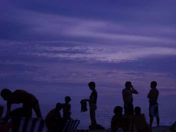 Sunset on the beach in Rio. (JAMES FLINT)