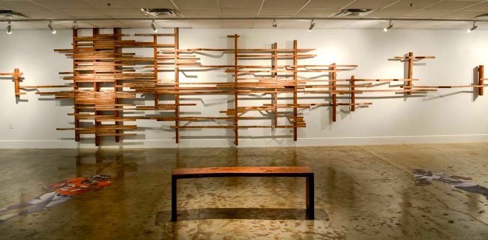 "Frame Out  by  Nick Gilmore,  salvaged dade county pine lumber, 8'h x 35' long, 2014. Bench:  black walnut w/dade county pine inlay, (57"" x 12"" x 18"" h), 2014"