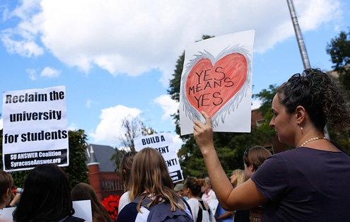 """A pro- yes means yes"""" protest at Syracuse University in 2014: the law they are a-changin'."""