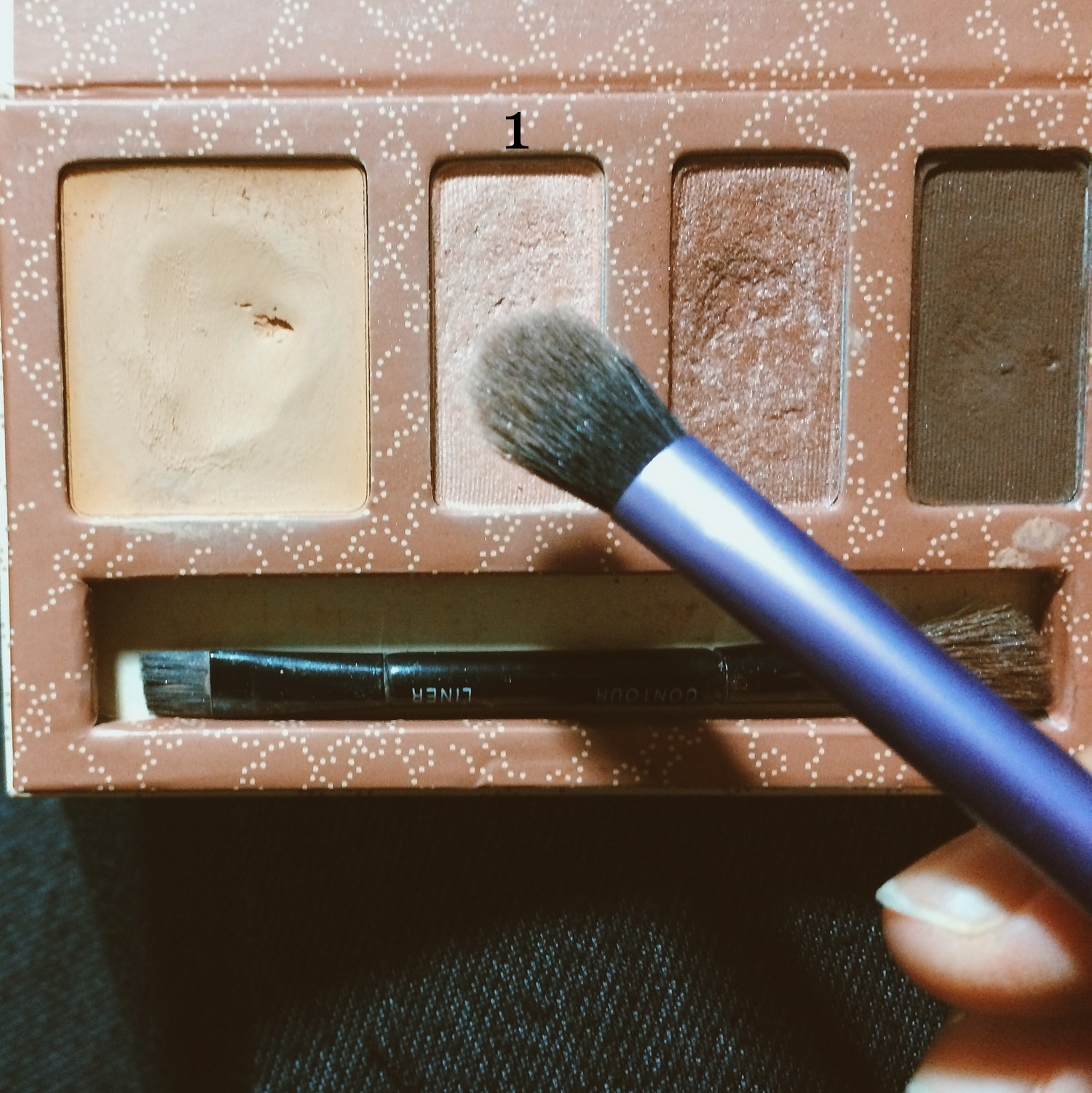 Take the first eyeshadow shade from the palette, and using a flat eyeshadow brush, press the champagne color all over the lids. you can use your own eyeshadow palette if you don't have this exact one.