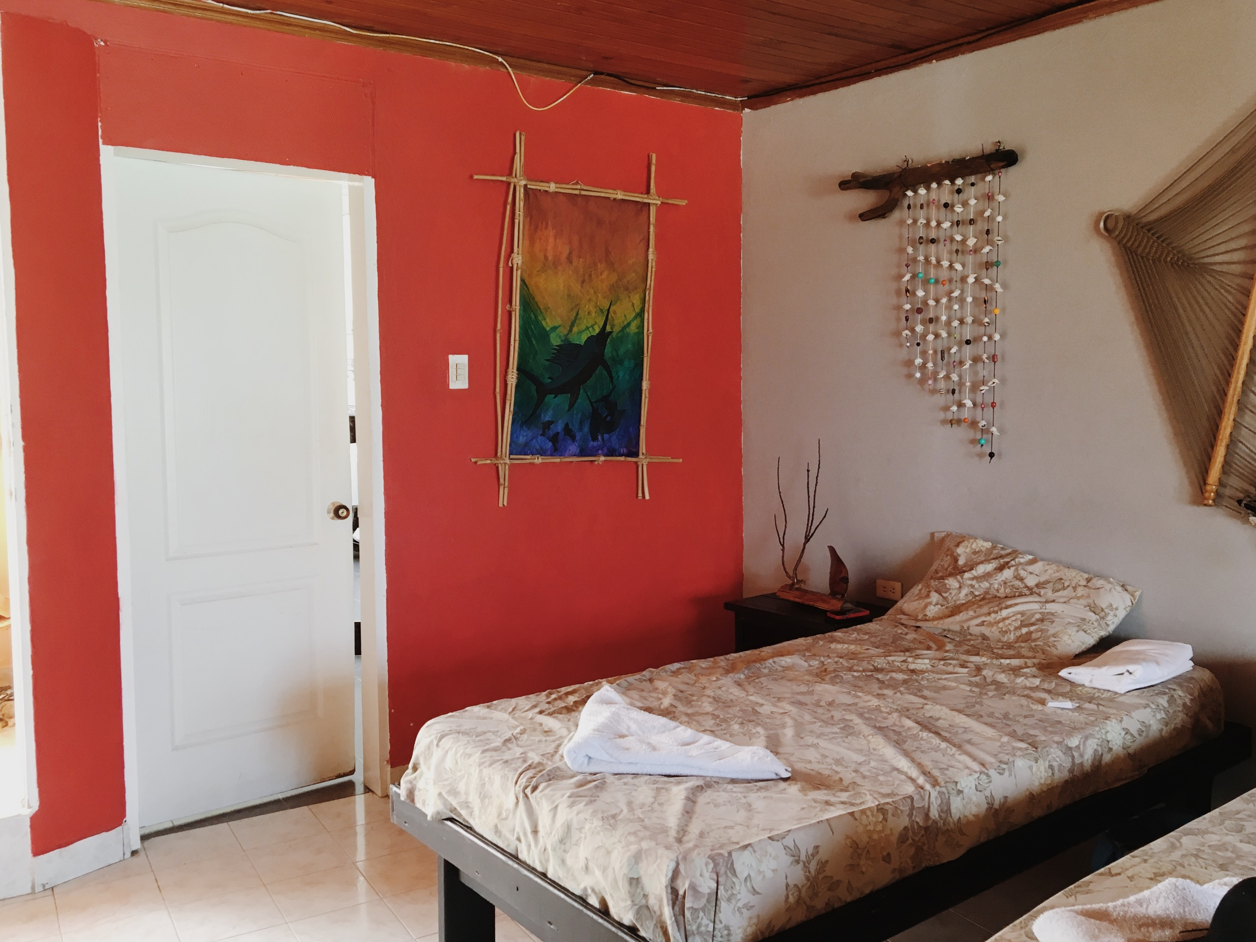 Love the red accent wall and decor in our room!
