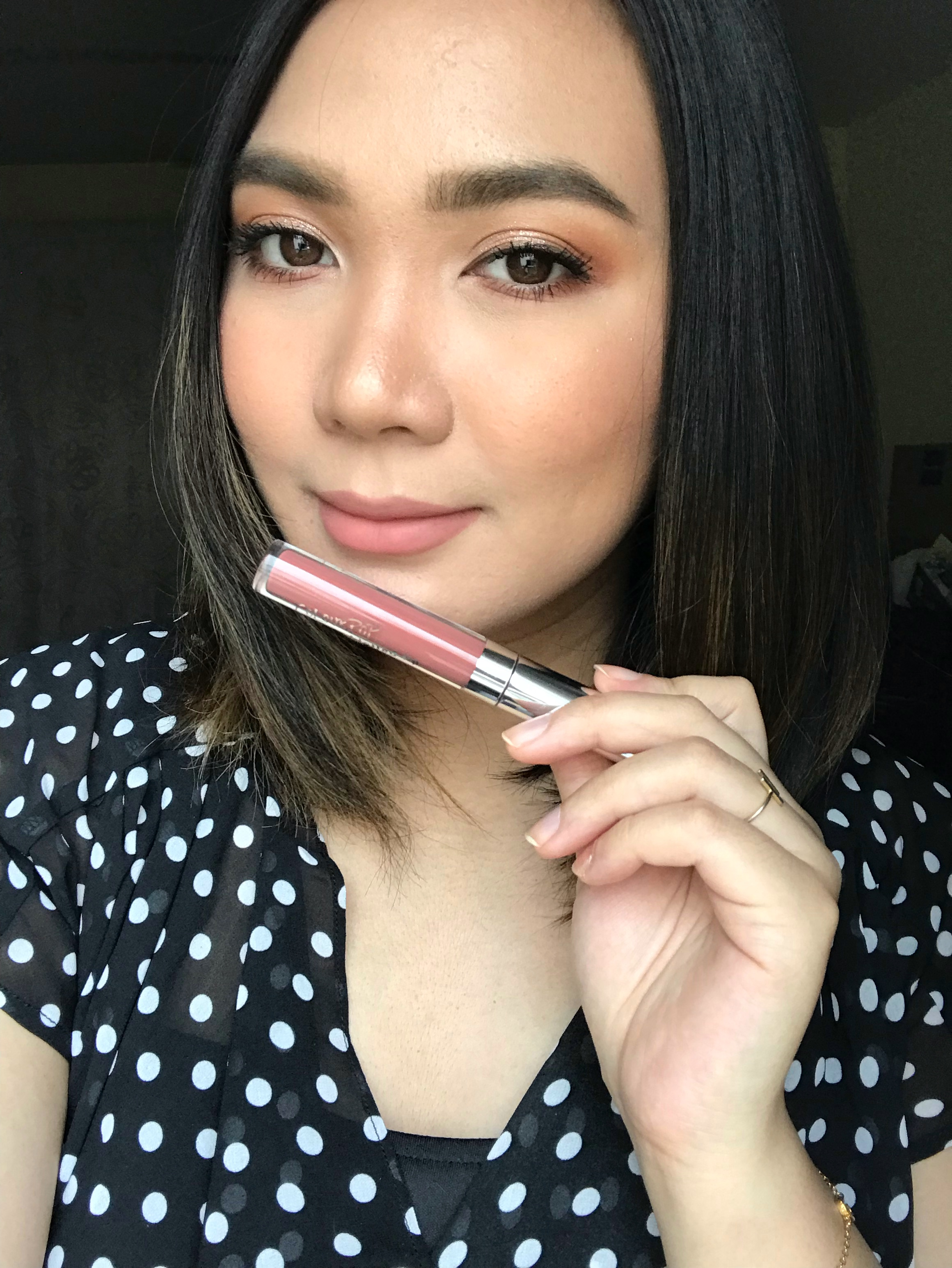 It's transfer-proof, and it makes my lips look so smooth!  THIS PHOTO IS NOT EDITED so you can see the actual color of the lipstick.
