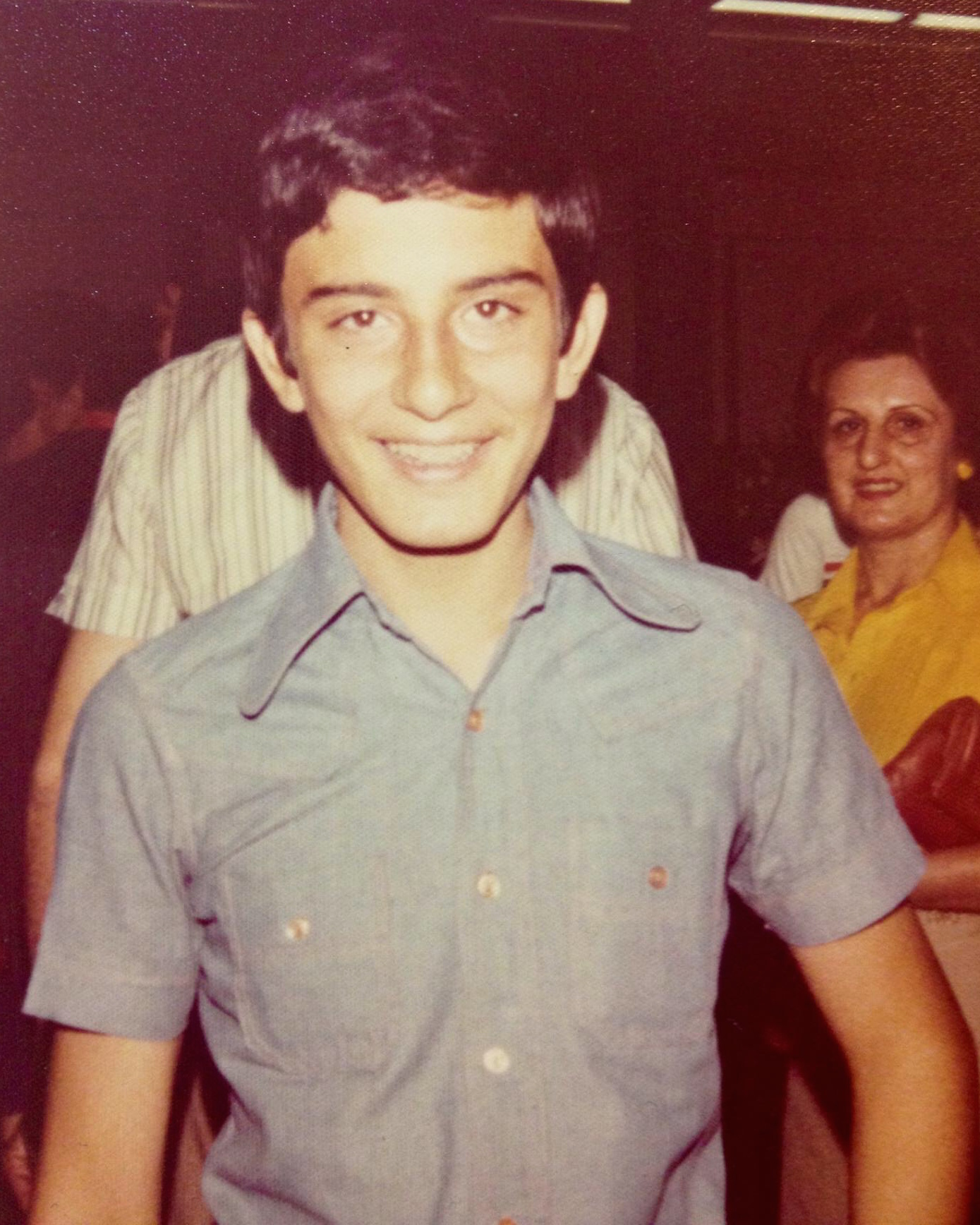 Me, moments before I boarded the plane to the US in Tehran in 1978. I can't imagine what my mom (in the background)was thinking/feeling at that moment.