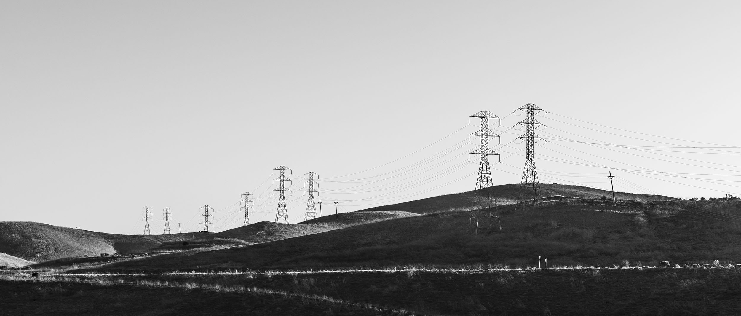 Power lines trail off into the distance over the rolling hills of San Ramon