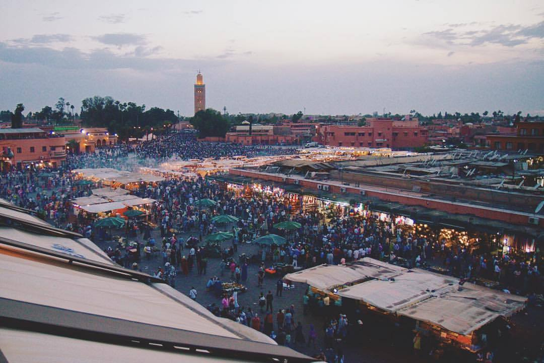 when the sun sets on Jemaa el-Fna the crowd multiplies and the massive throng of people turn from the light of day to the magic of night (at Jemaa El-Fnaa)