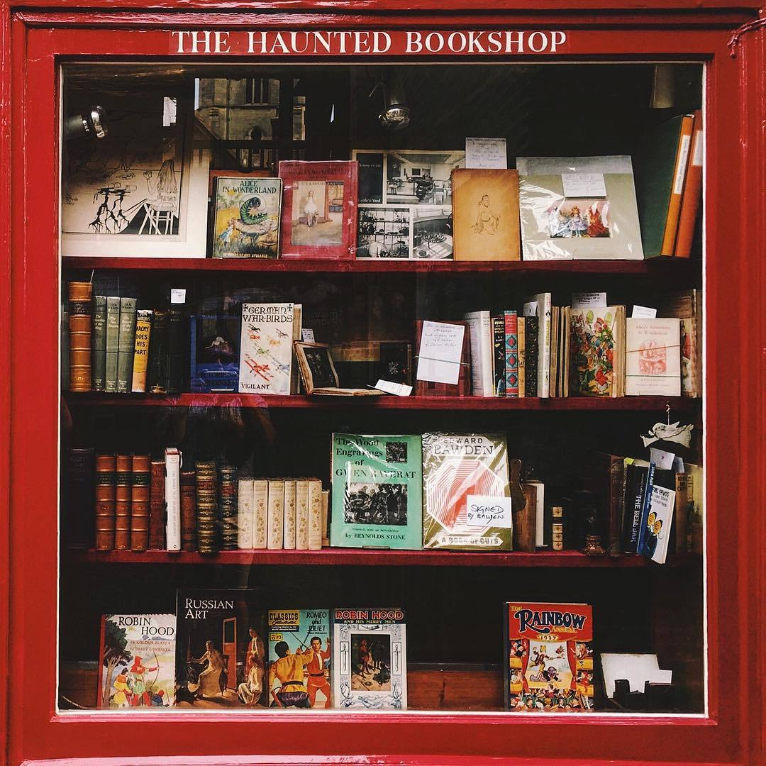 One of the most endearing things I love about England is the cultural omnipresence and acceptance of ghosts.  Anyone see the ghost in this photo? (at The Haunted Bookshop)