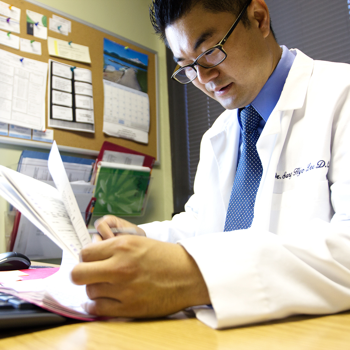 stock-photo-12059470-handsome-doctor-with-chart.jpg