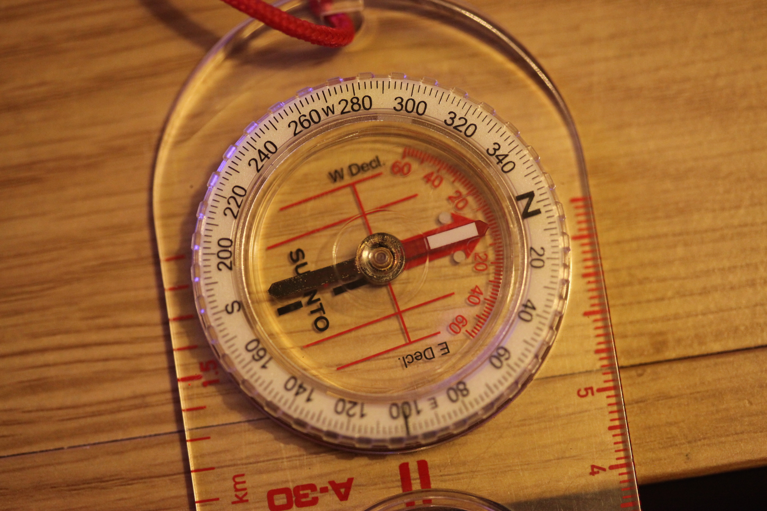 Orientate your compass (spin round) until the two 'North' arrows line up.