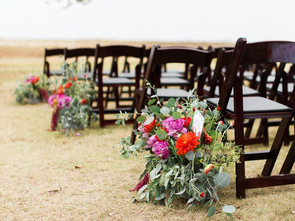 The floral arrangements decorating the aisle gave beautiful pops of color