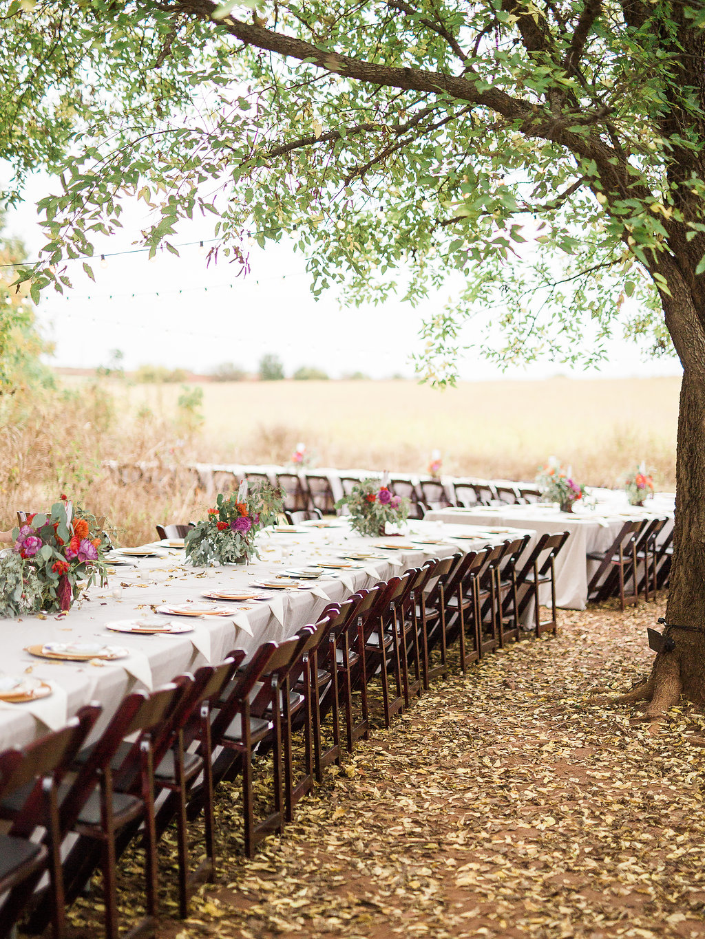 A perfect fall day! The fallen leaves could not be more beautiful as they somehow tie into the lovely gold accents on the table