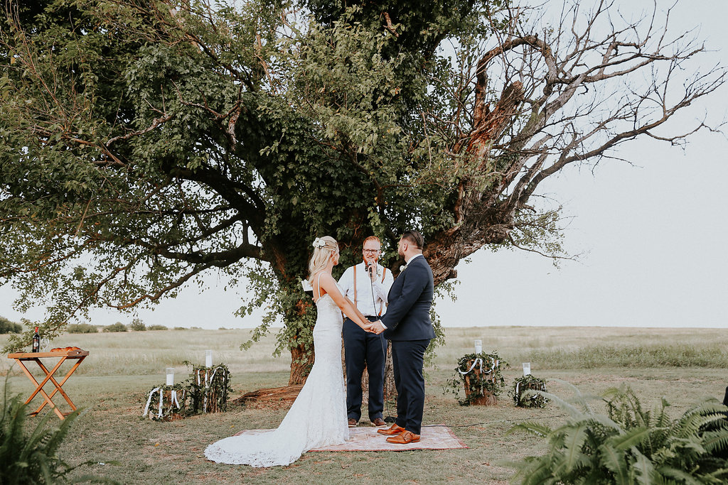 Fresh ferns guide the couple down the aisle, and give even more greenery to the event!