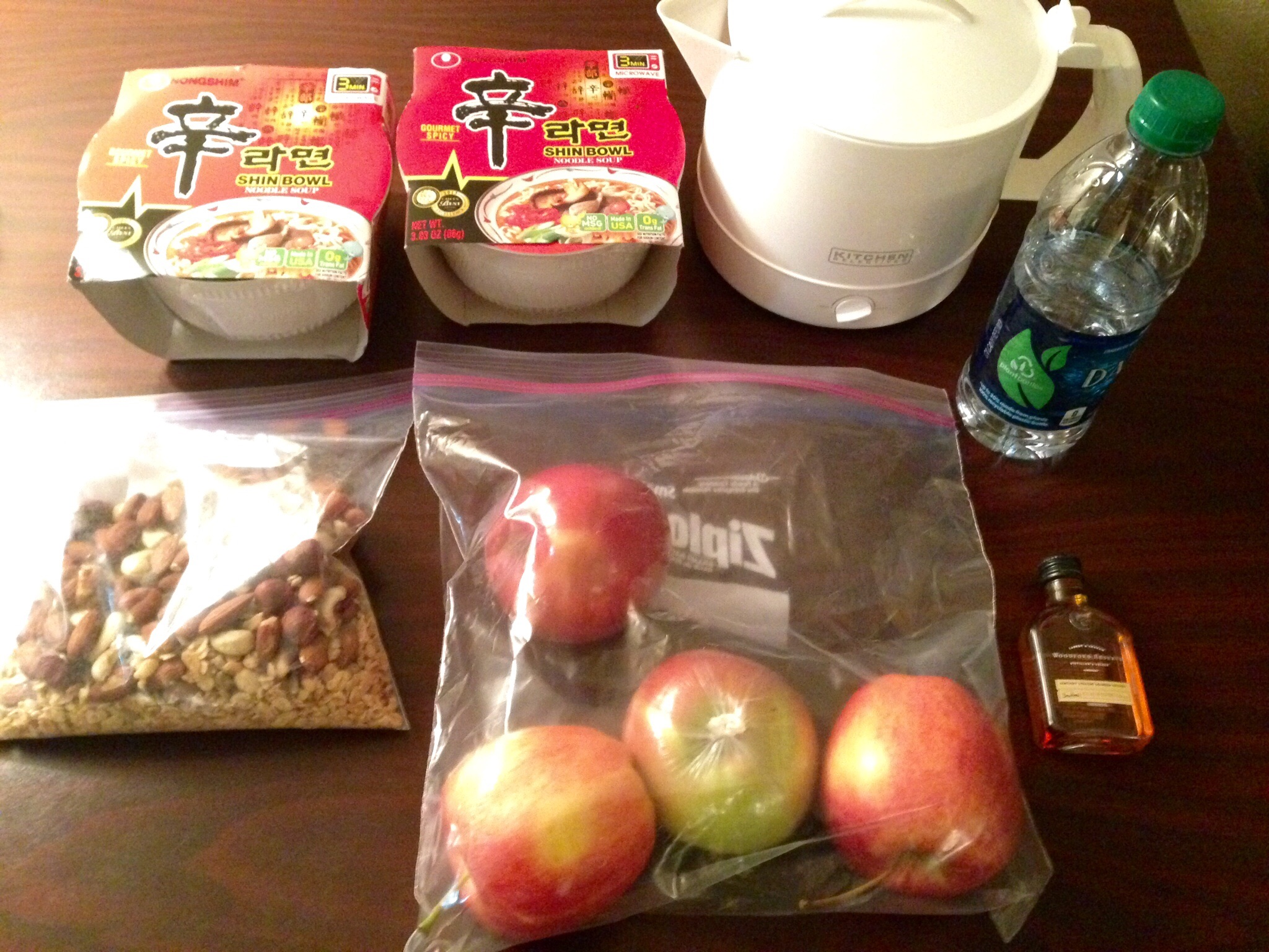I don't usually carry this much food with me. Granola mix and mixed nuts are easy easy to travel with. Apples supplement some much needed vitamins (I picked up several more from Atlanta's Delta Skyclub lounge). This time I also brought couple of Shin Noodle Bowl and a water boiler!