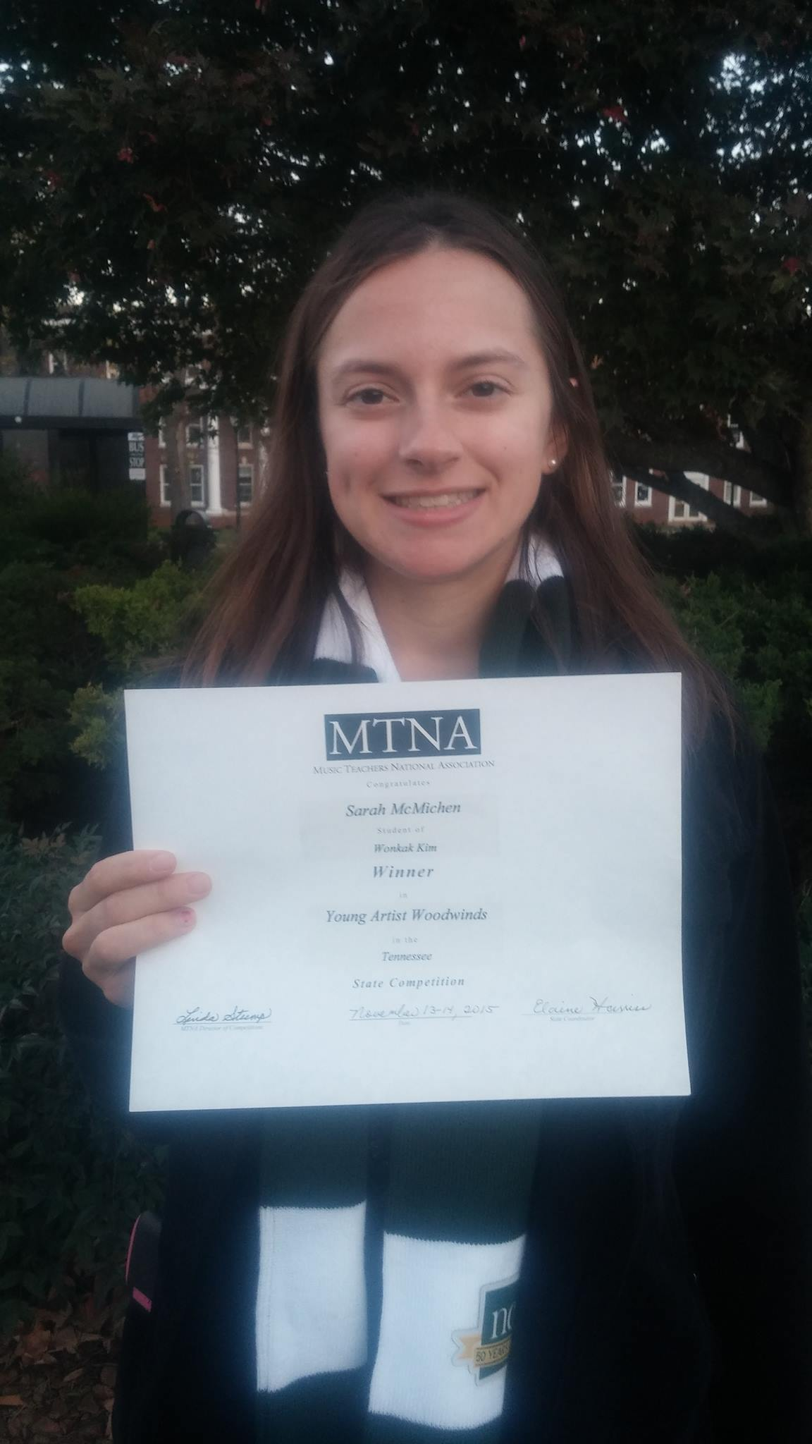 Sarah with her award certificate - MTSU campus