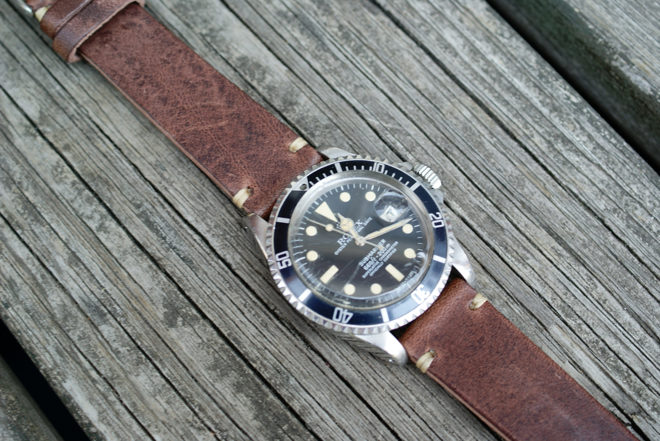 Rolex 1680 Submariner on a classic vintage leather strap.